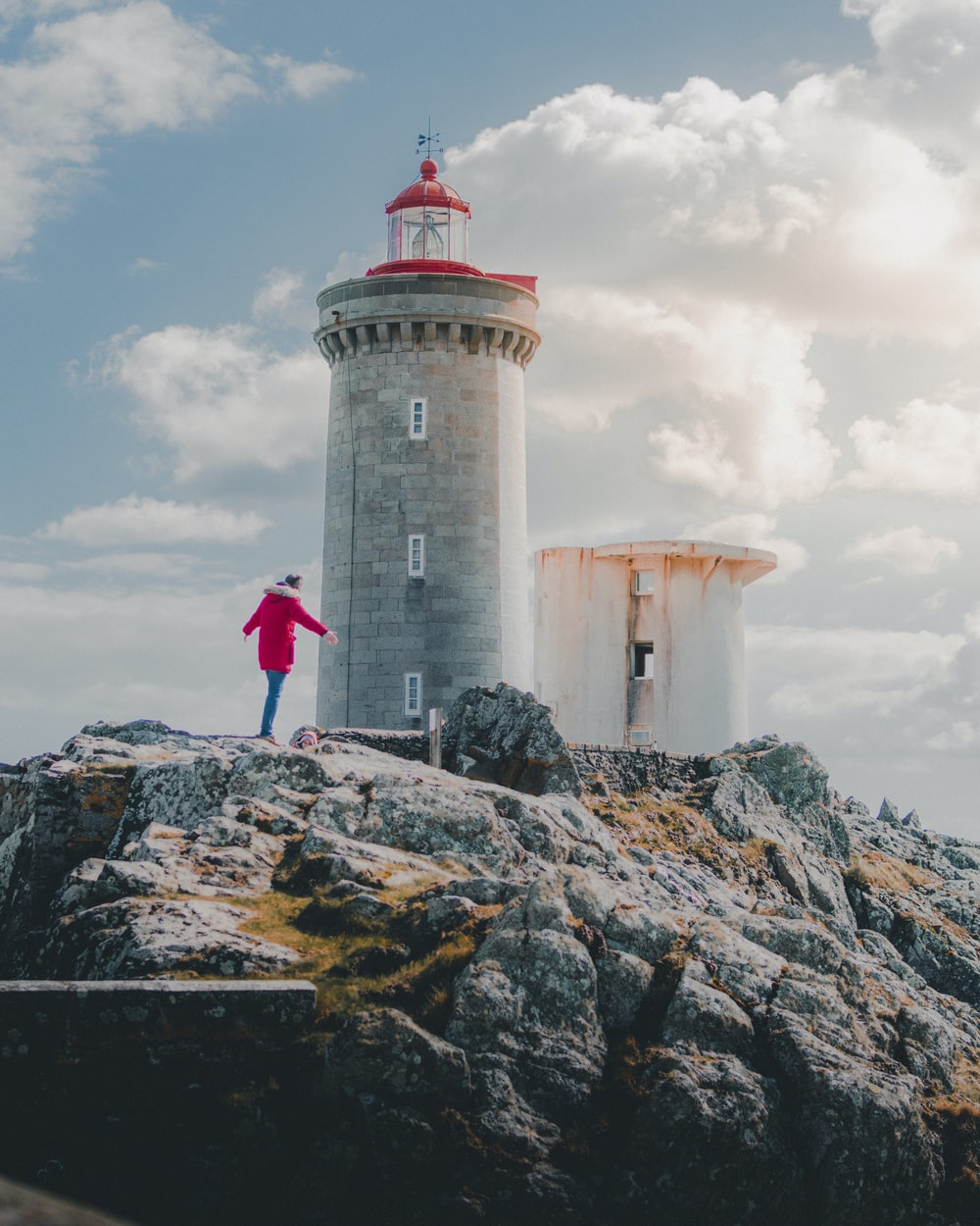 person standing near the lighthouse