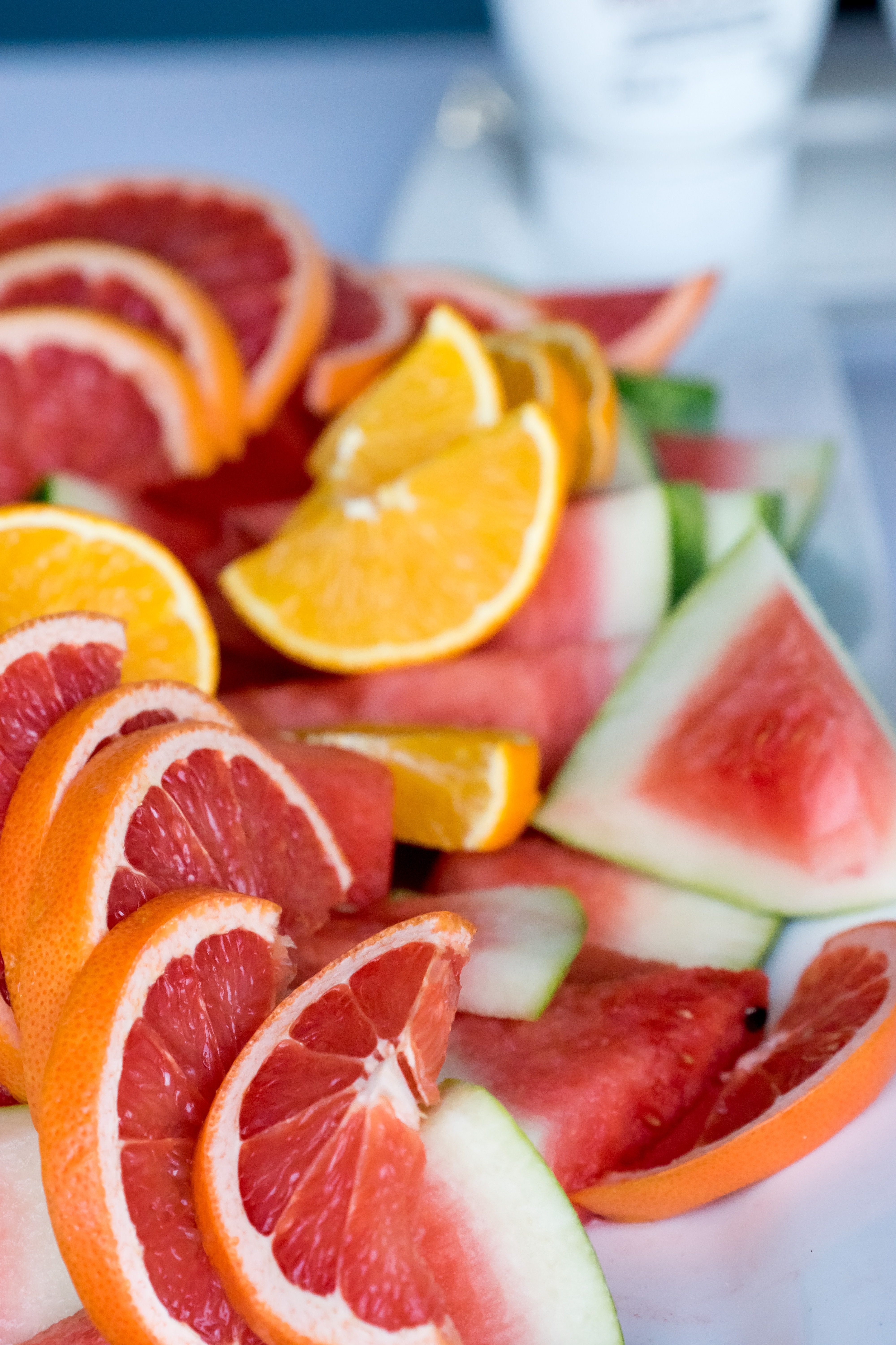 sliced citrus and melons