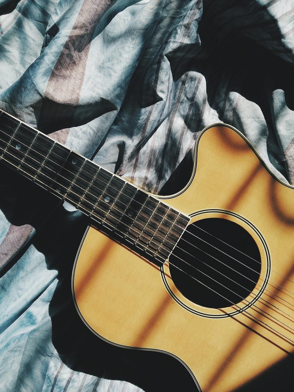 brown cut-away guitar