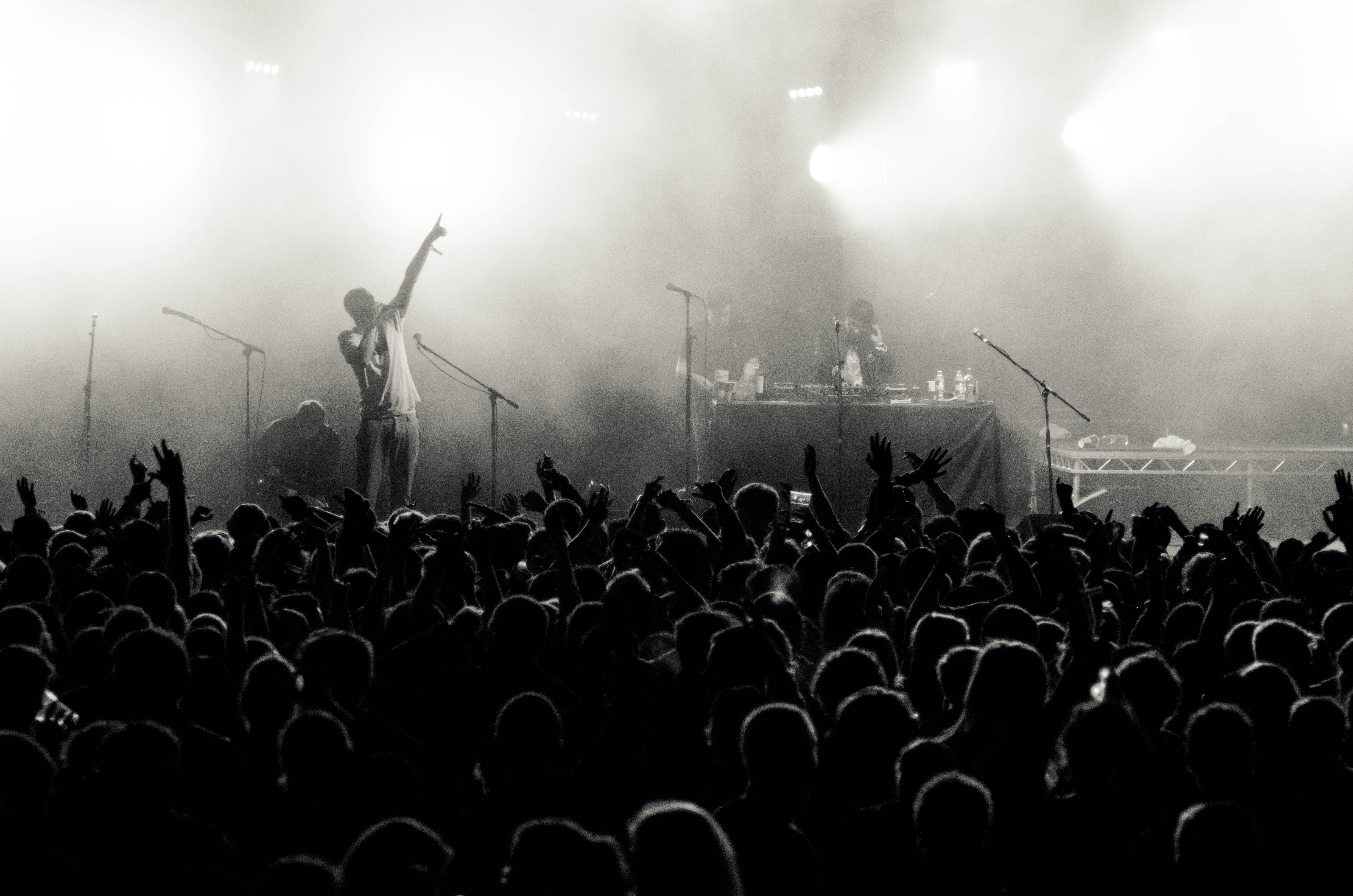 grayscale photo of people in concert