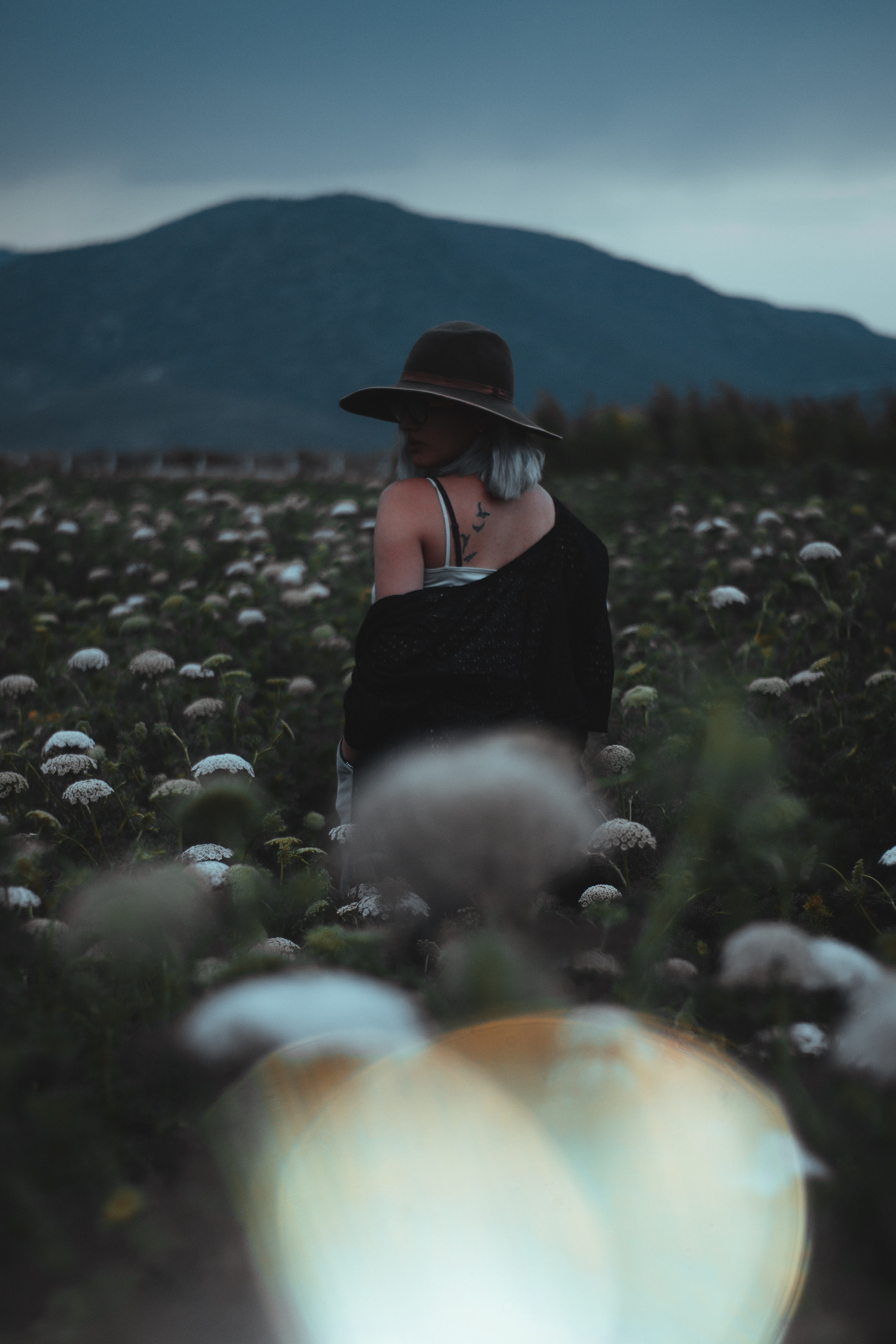 woman stating on flower field