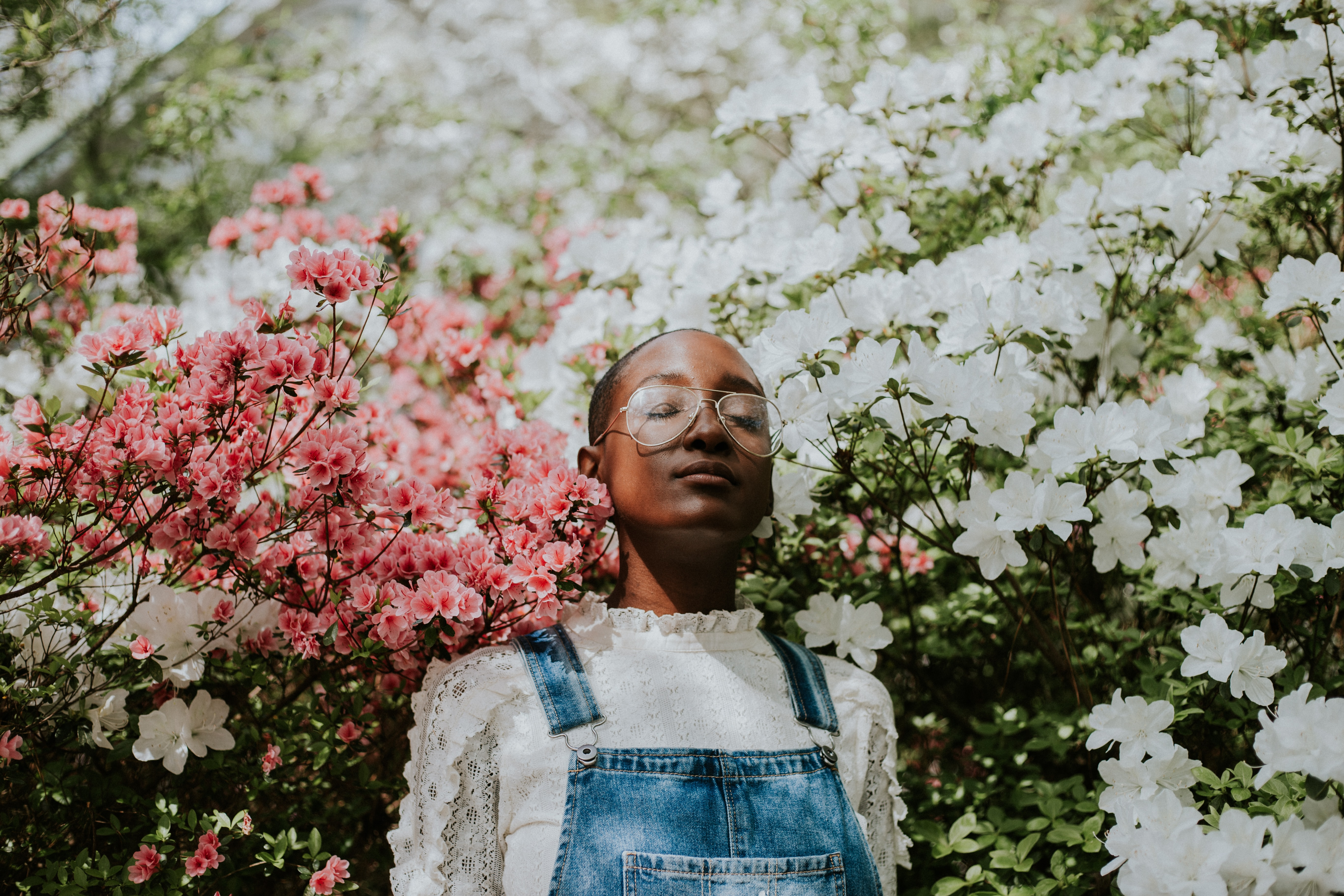 person standing beside flowers