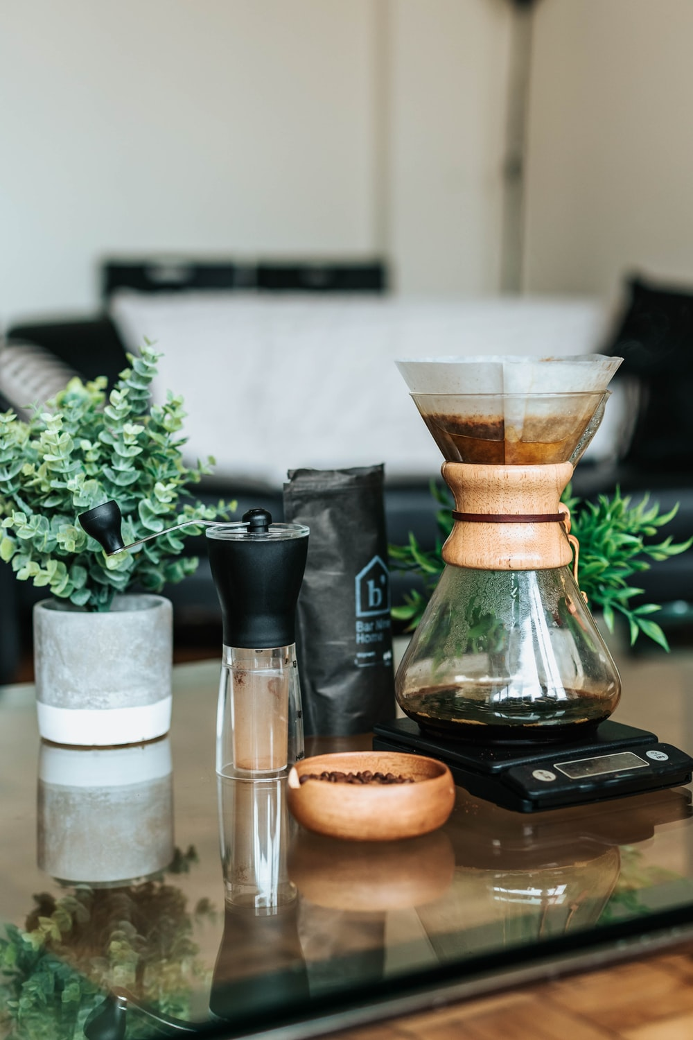 clear pour-over coffee brewer with digital scale