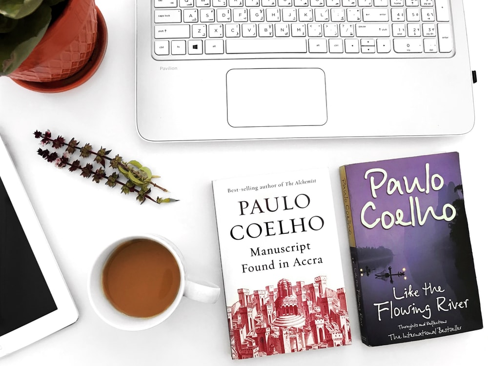 two Paulo Coelho books on table
