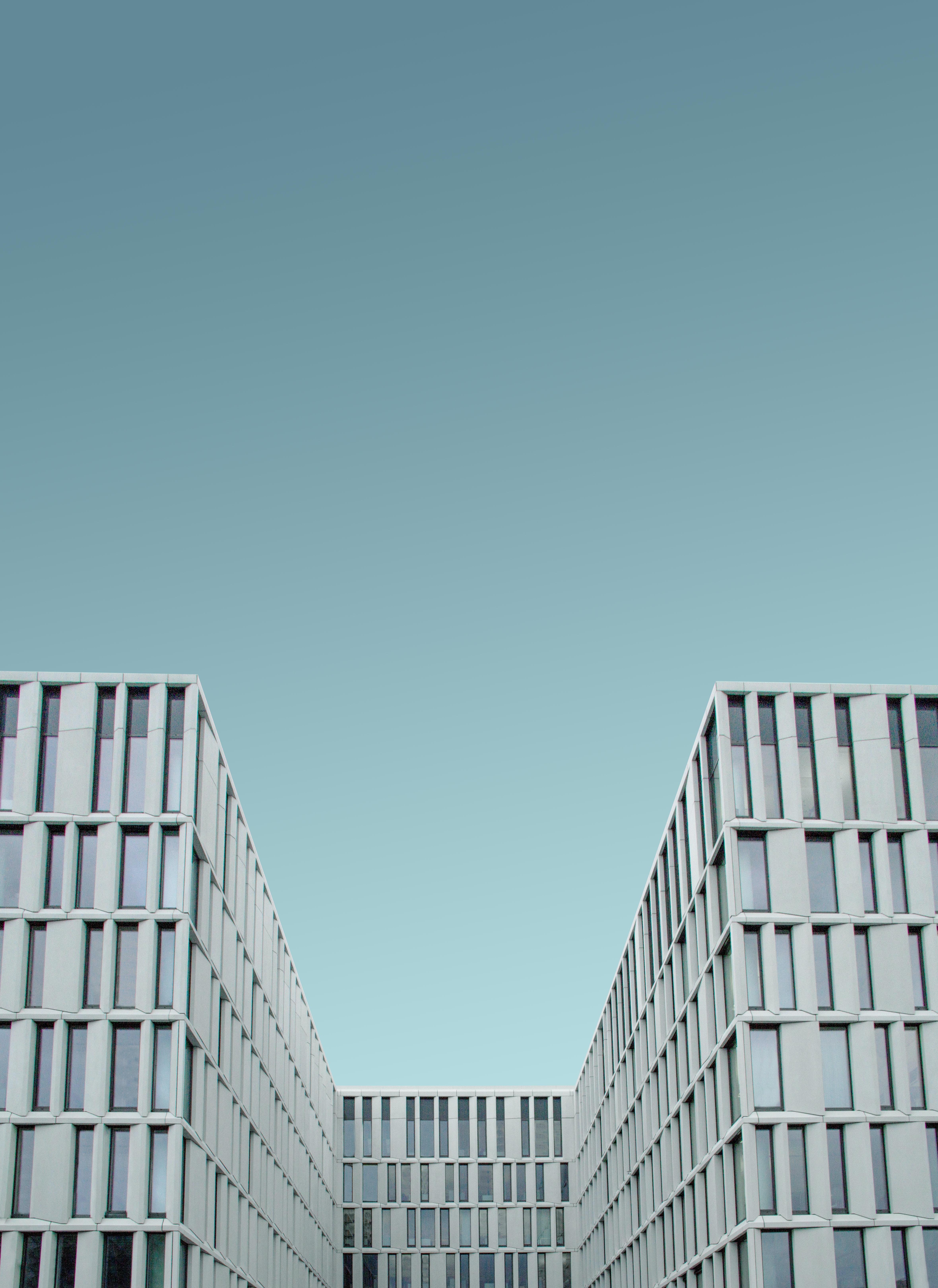 man's eye view of white quadrangle building