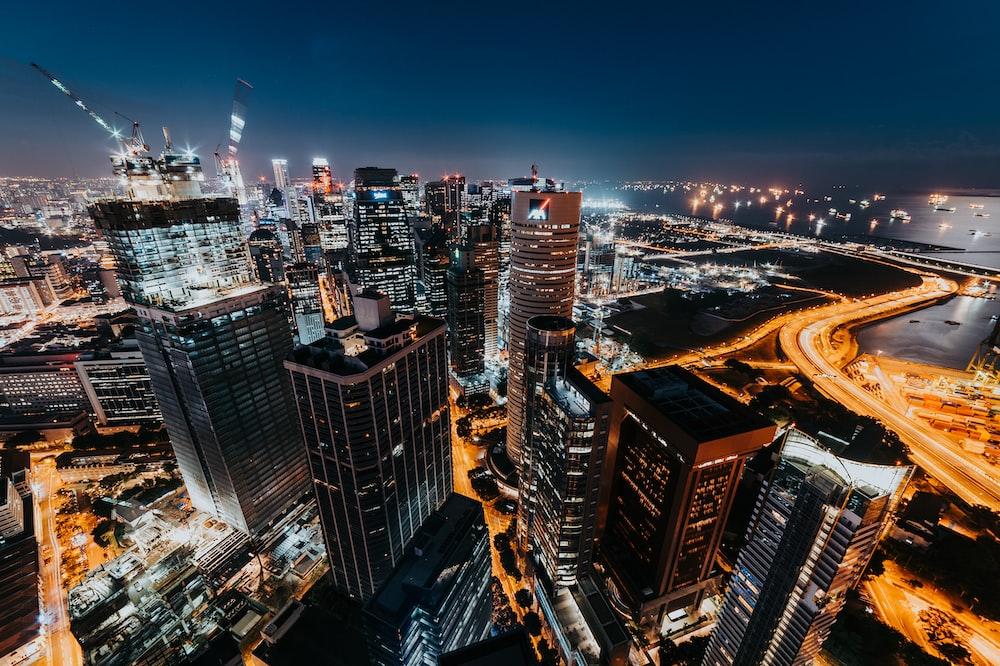 bird's eye and timelapse photography of city skyline
