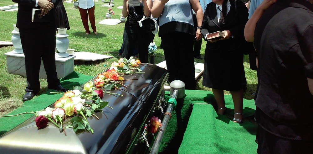 group of people attending burial