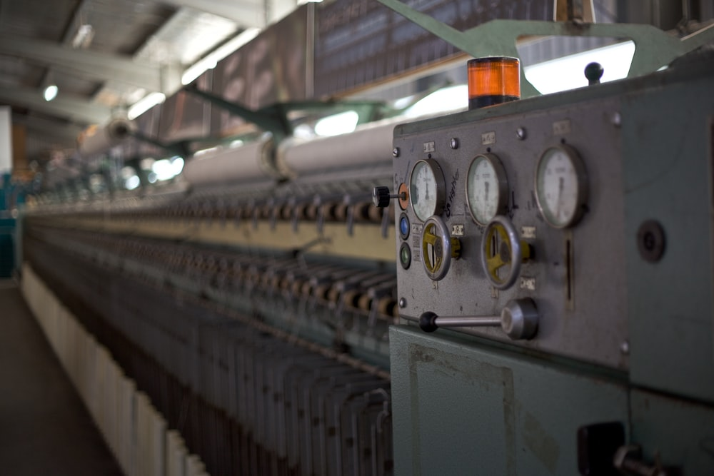 selective focus photography of machine