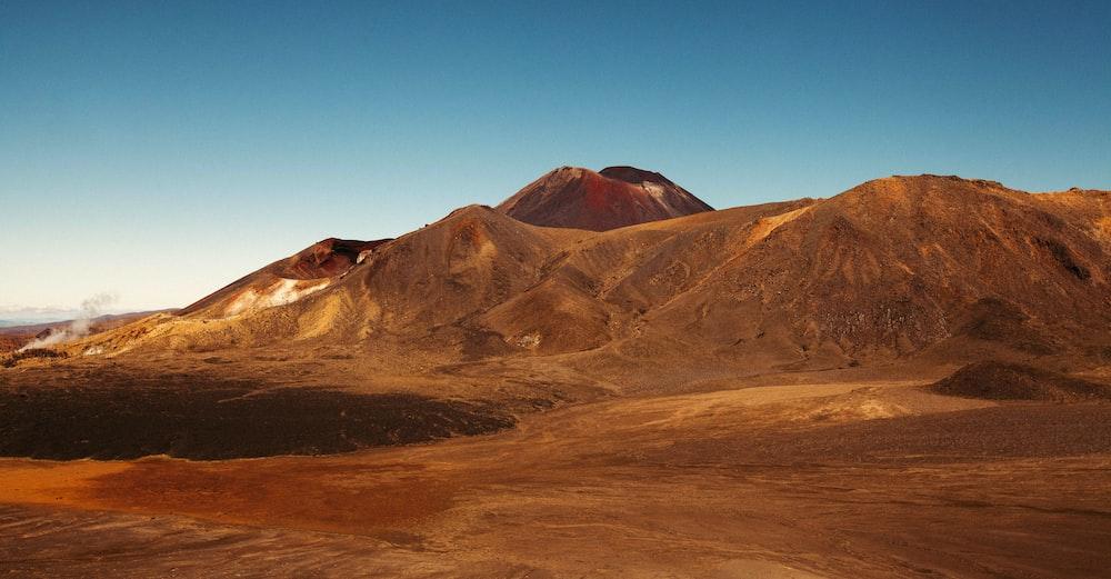 desert mountain under clear blue sky