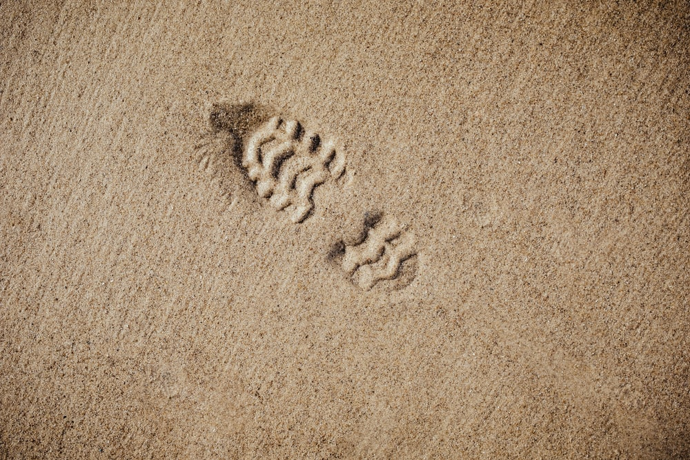 selective focus photography of foot print