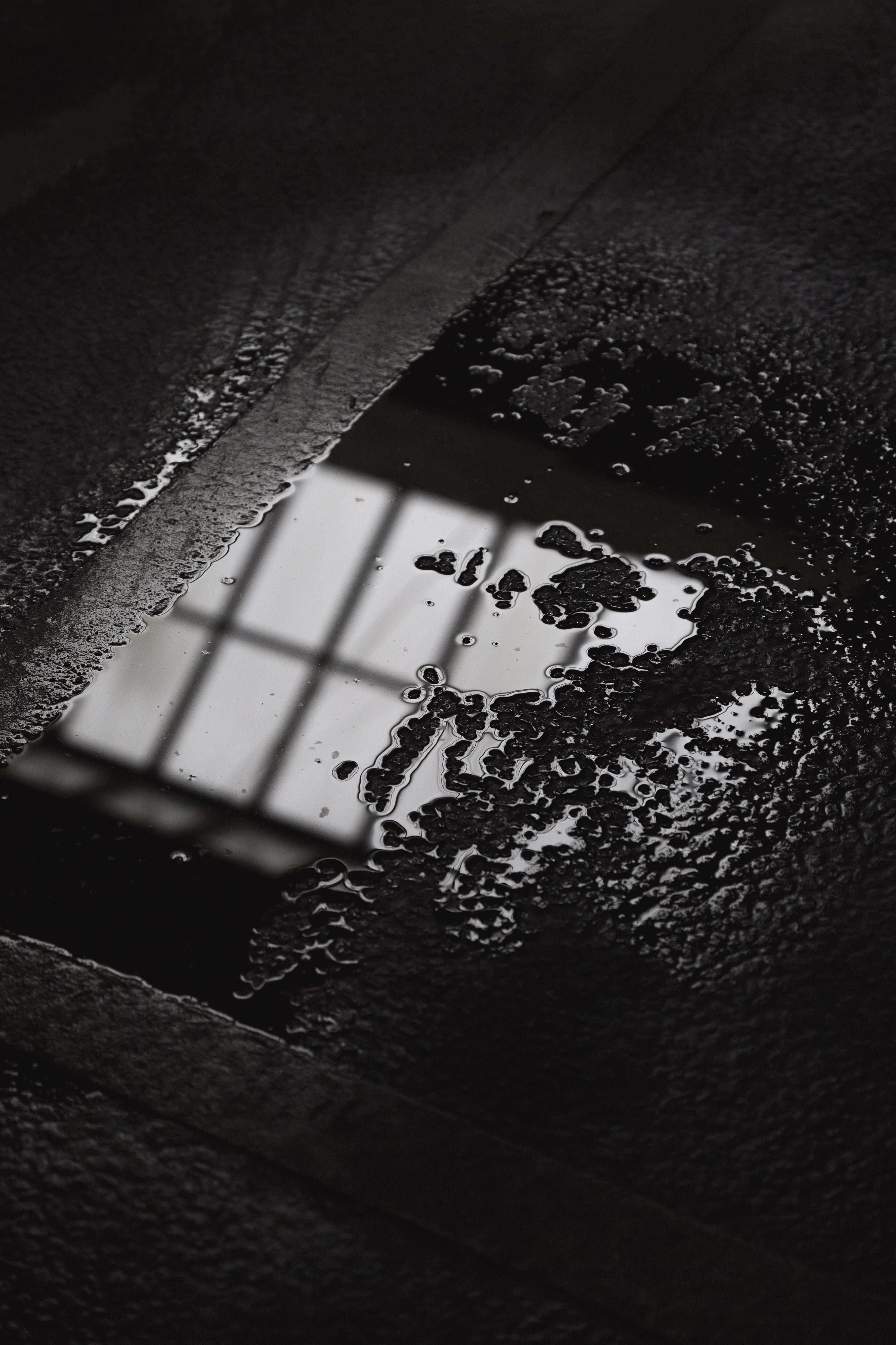 water drops on gray flooring