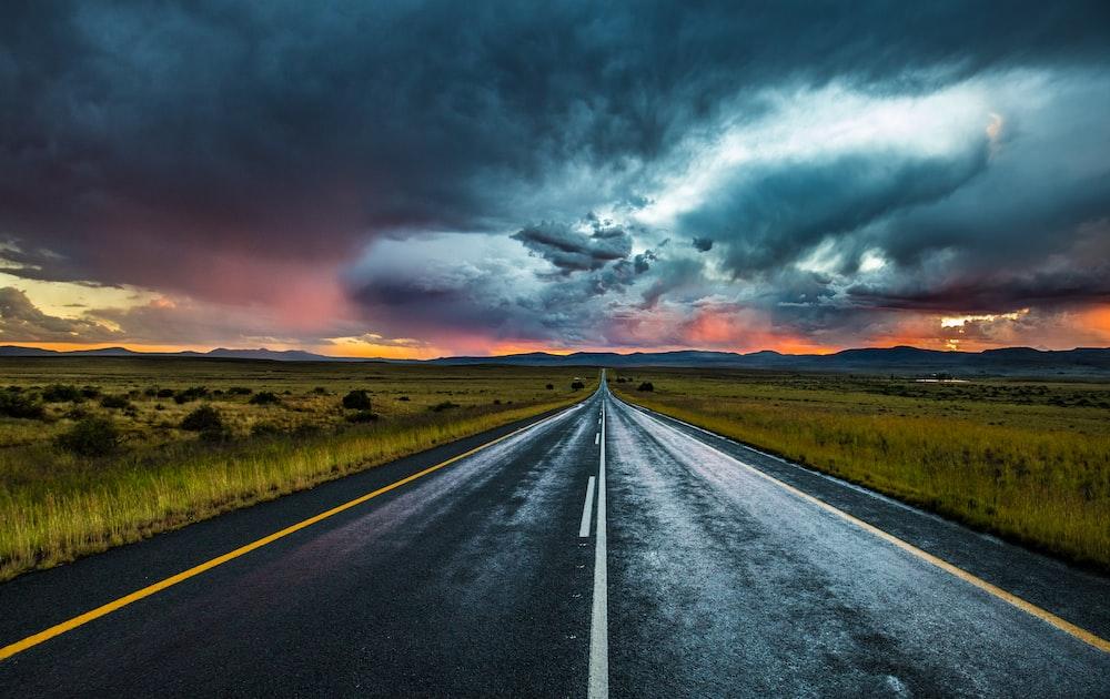asphalt road under nimbus cumulus
