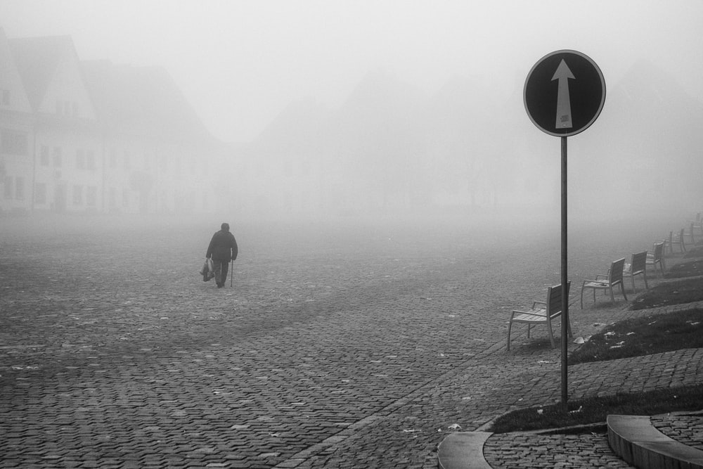 person walking on empty road