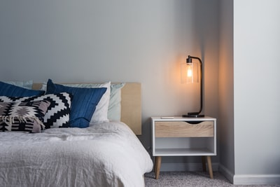 black table lamp on nightstand midcentury modern teams background