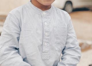 boy in white dress shirt smiling
