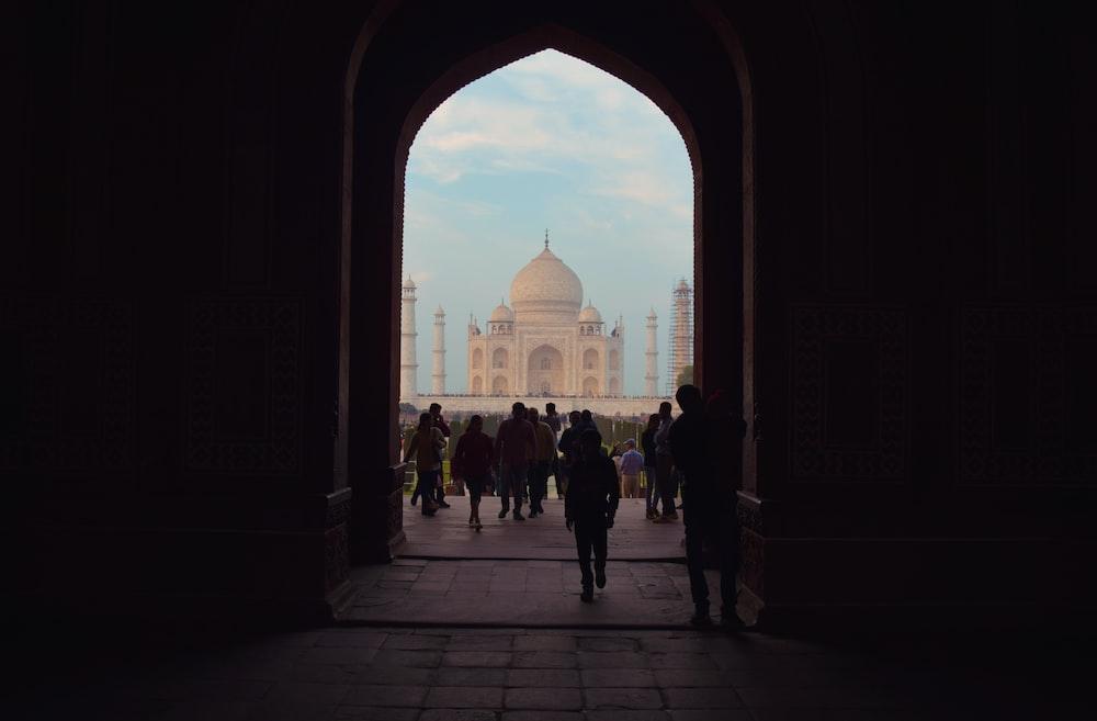 people standing near Taj Mahal