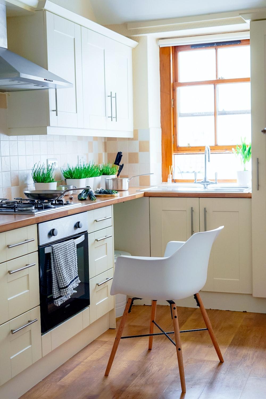 white chair near kitchen oven during daytime
