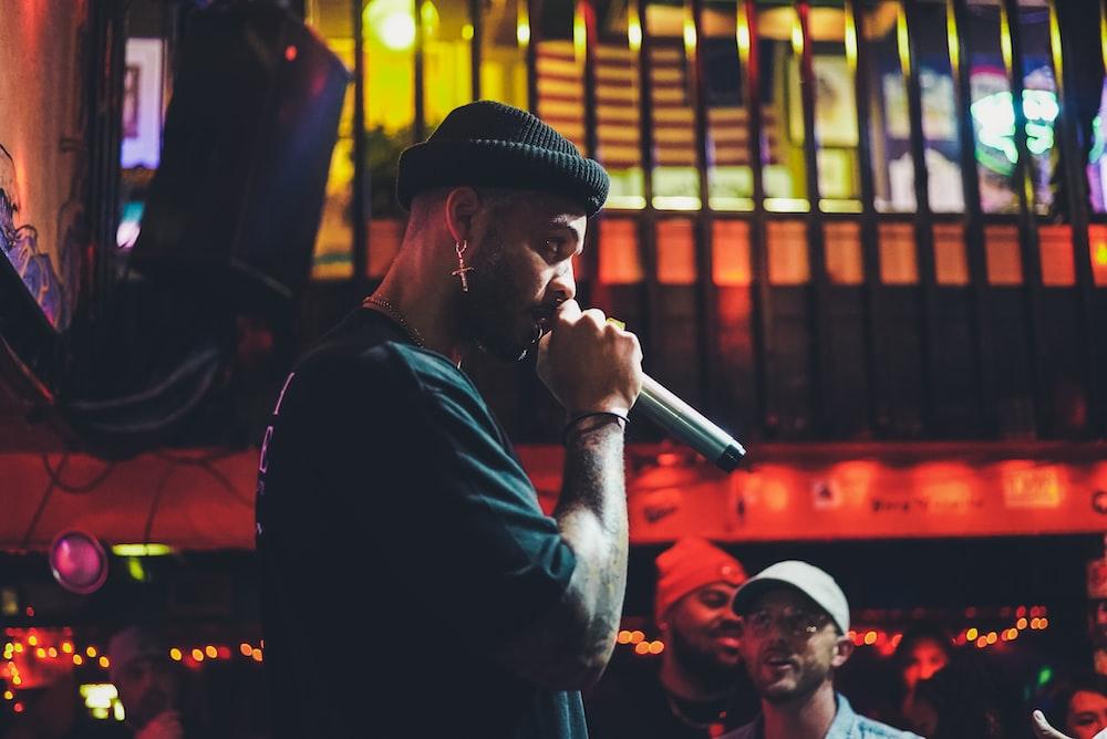 man holding wireless microphone