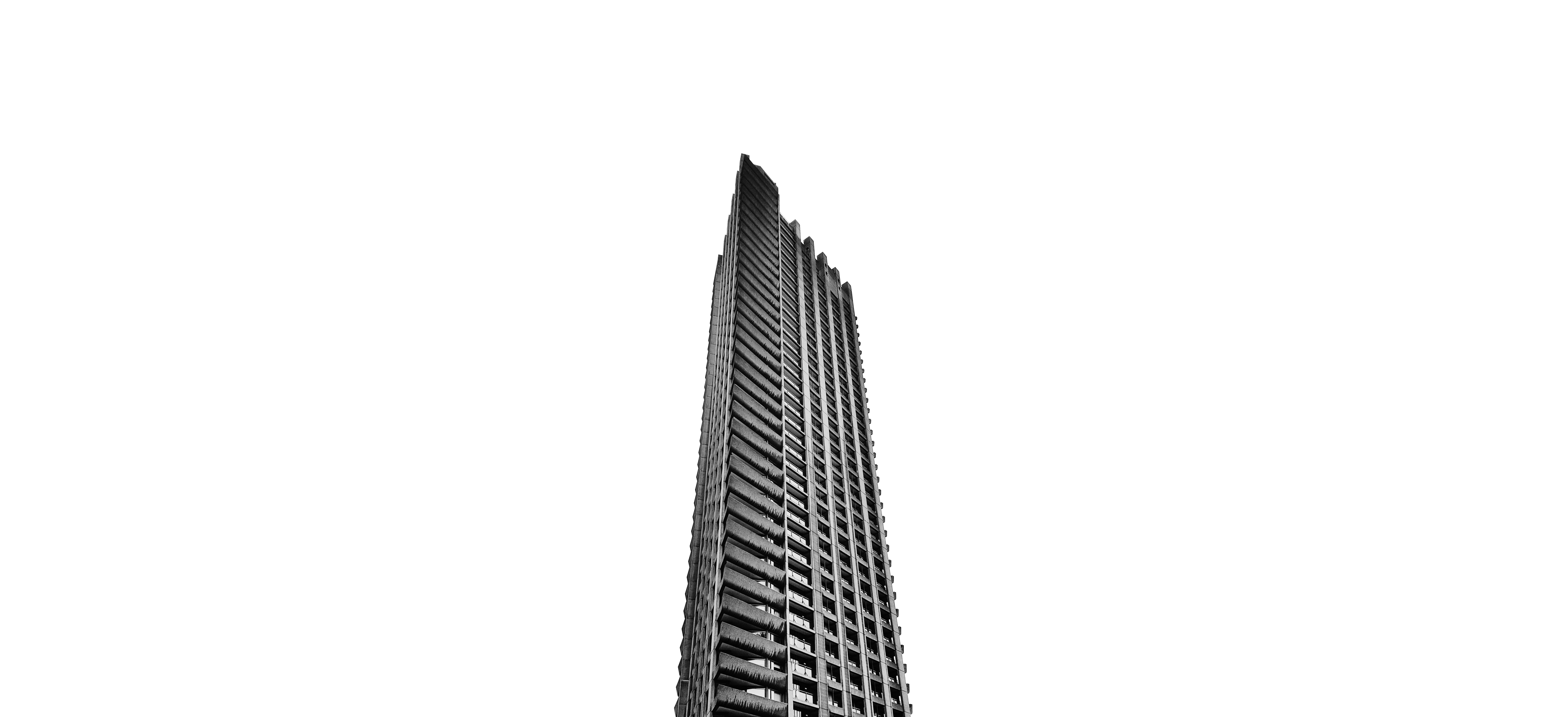 structural shot of gray building under cloudy sky