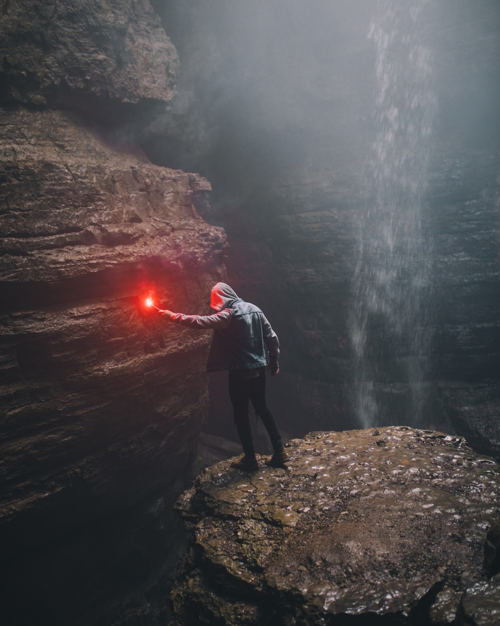 man holding flare in acve