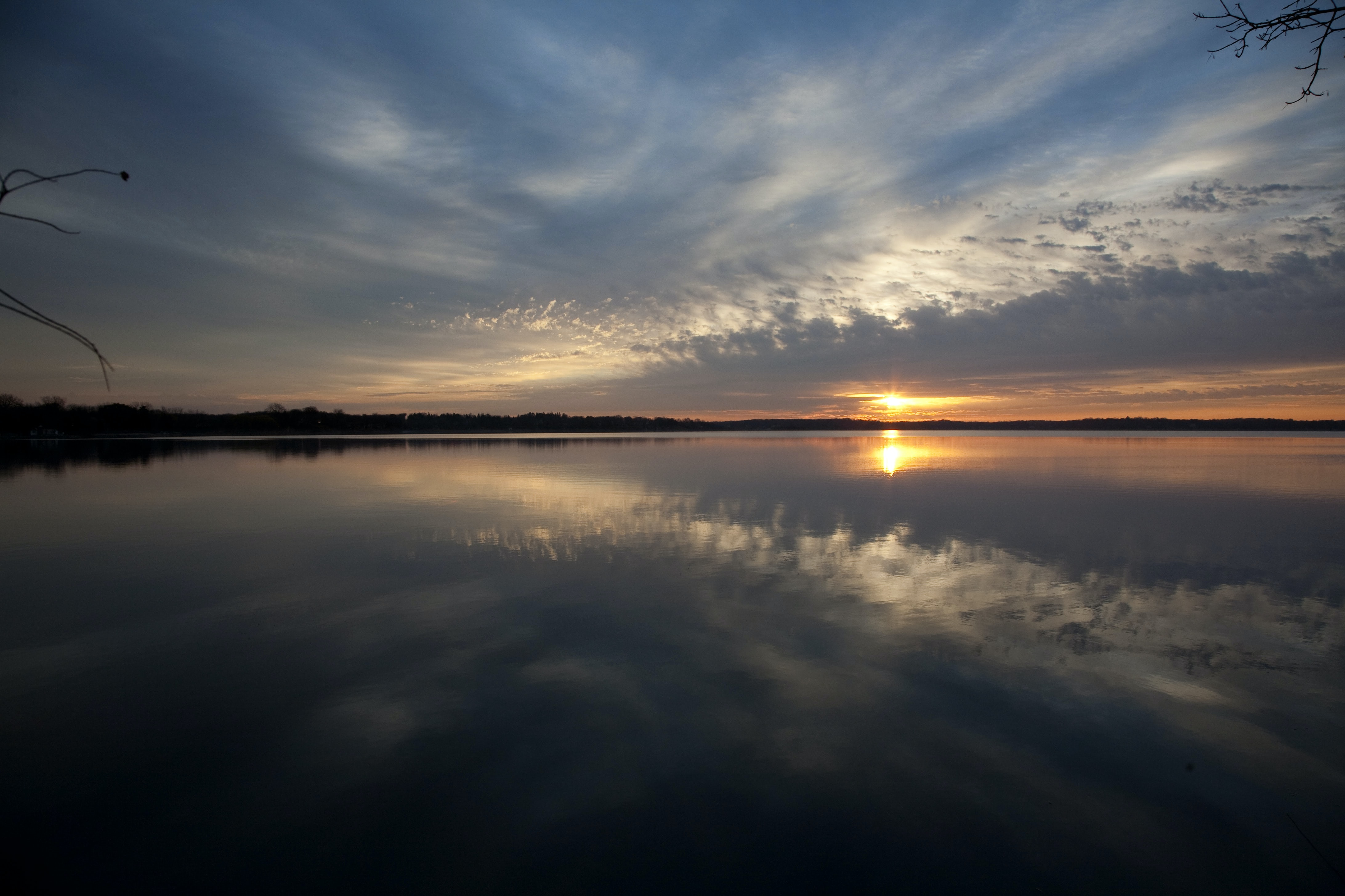 photo of body of water with sky reflection