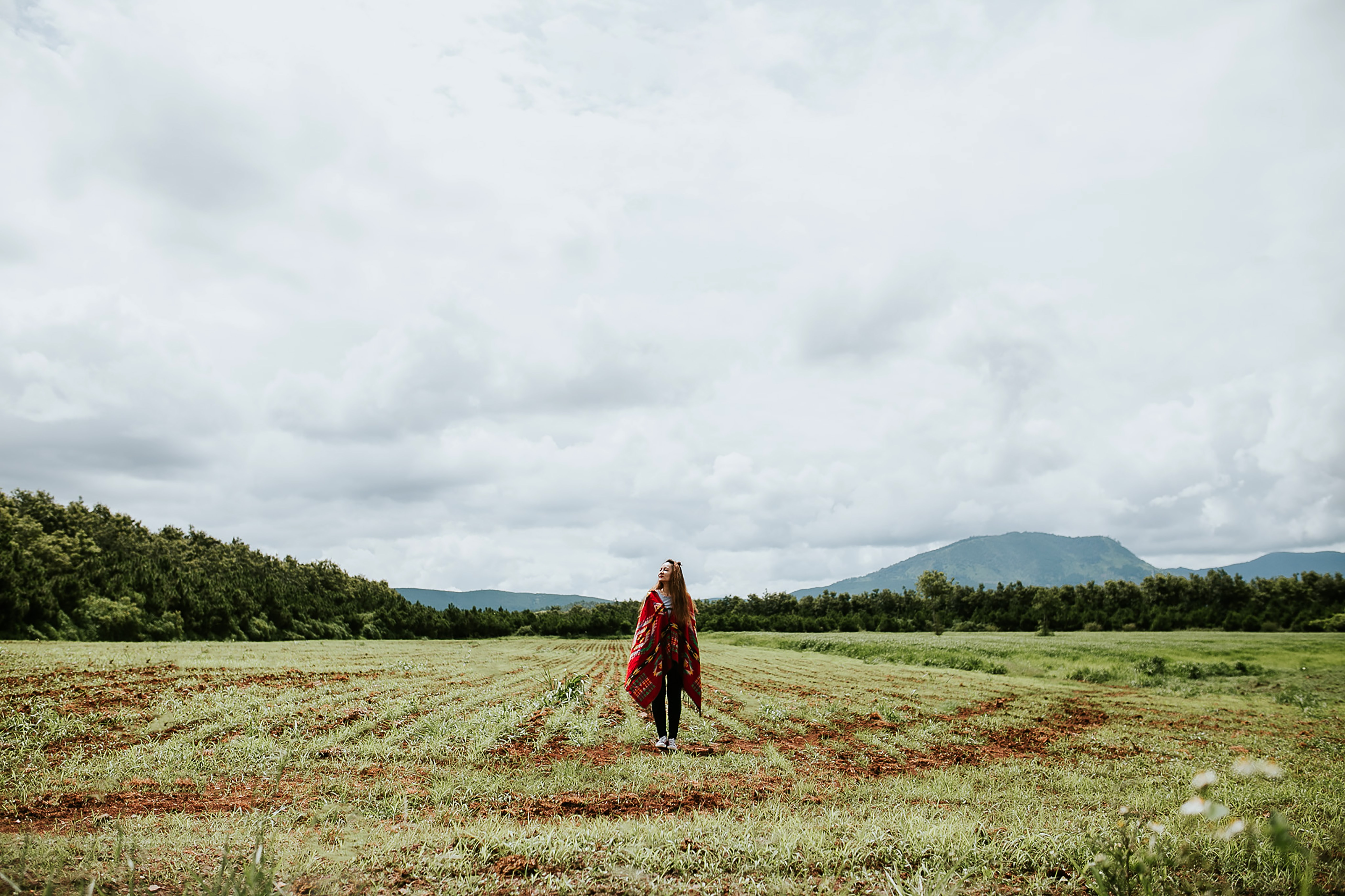 woman standing on green field