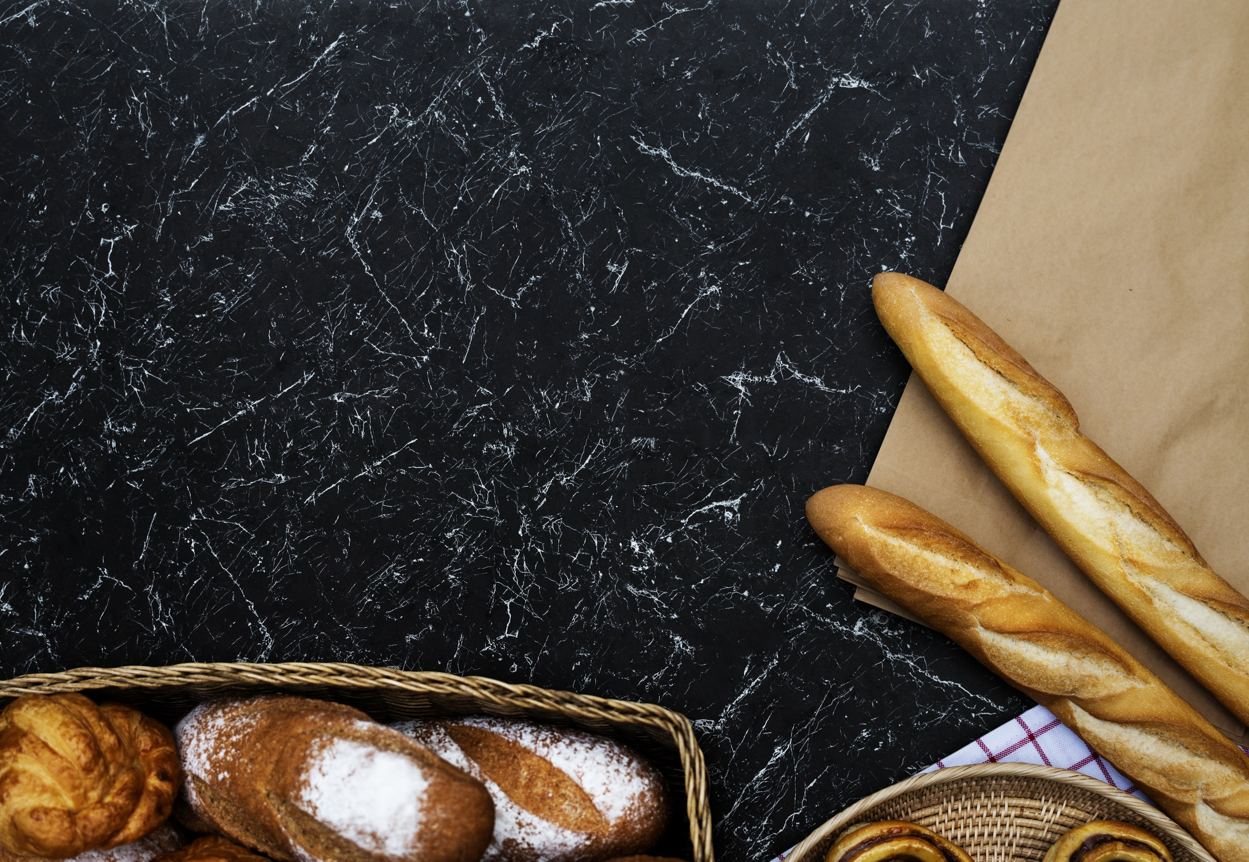 flat lay photography of French breads