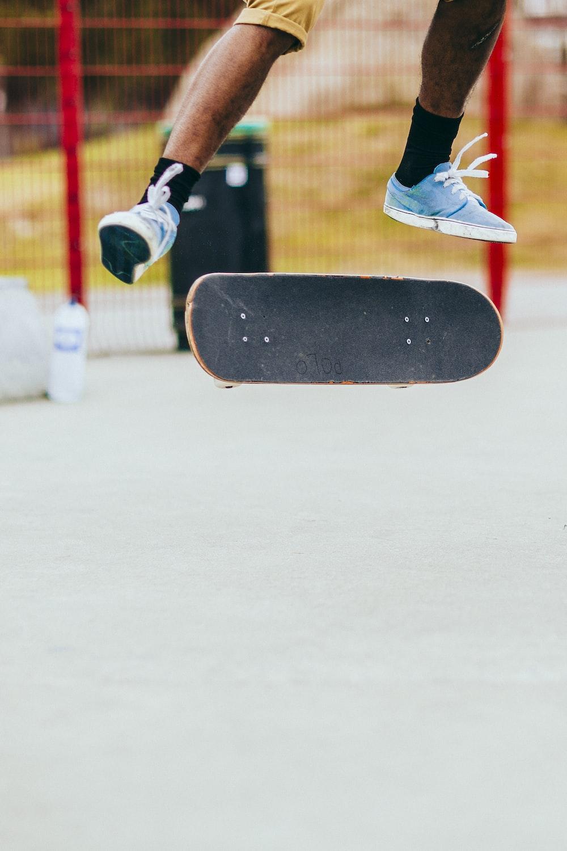 man playing skateboard while performing flip tricks