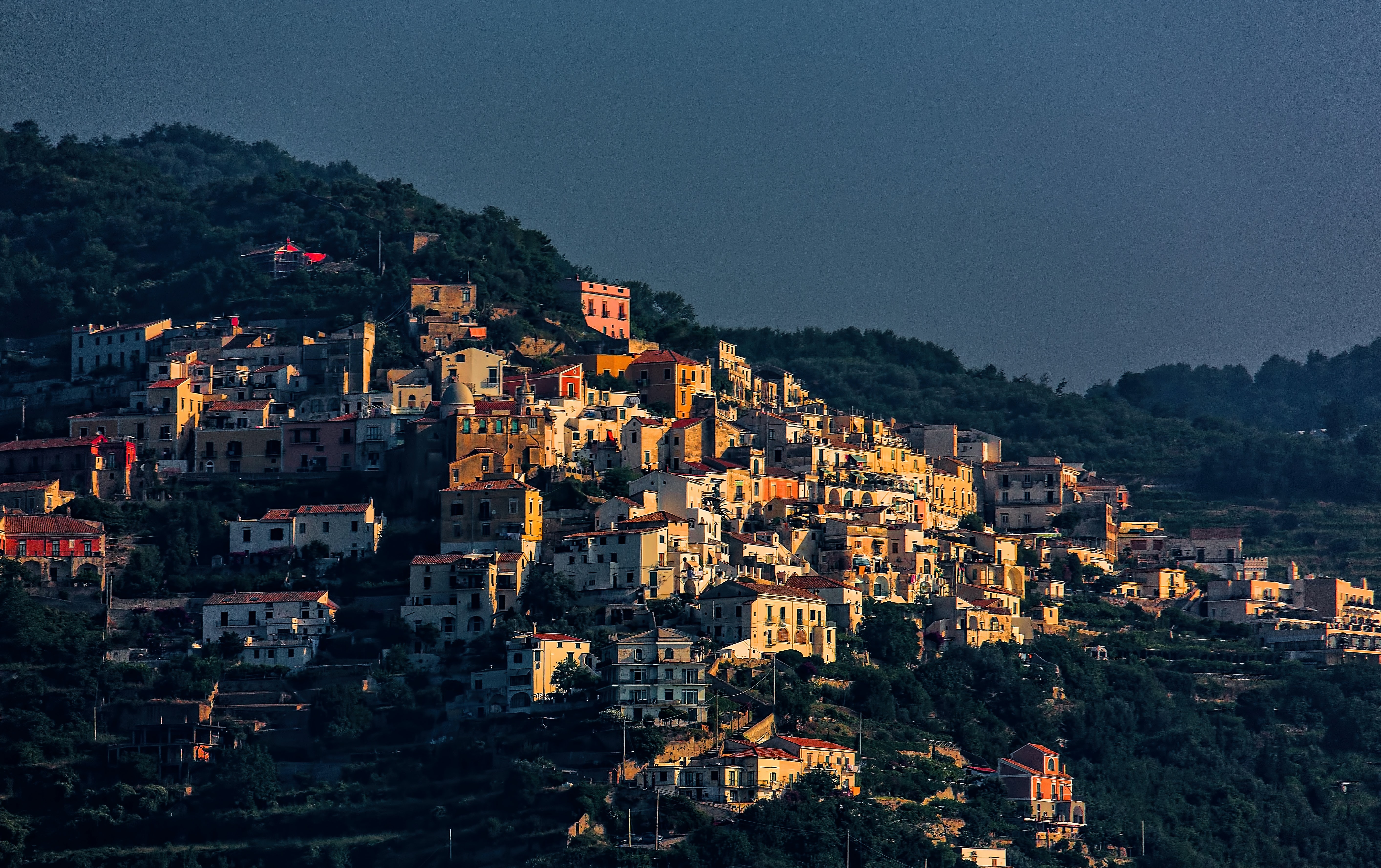 low-angle photography of town on mountain