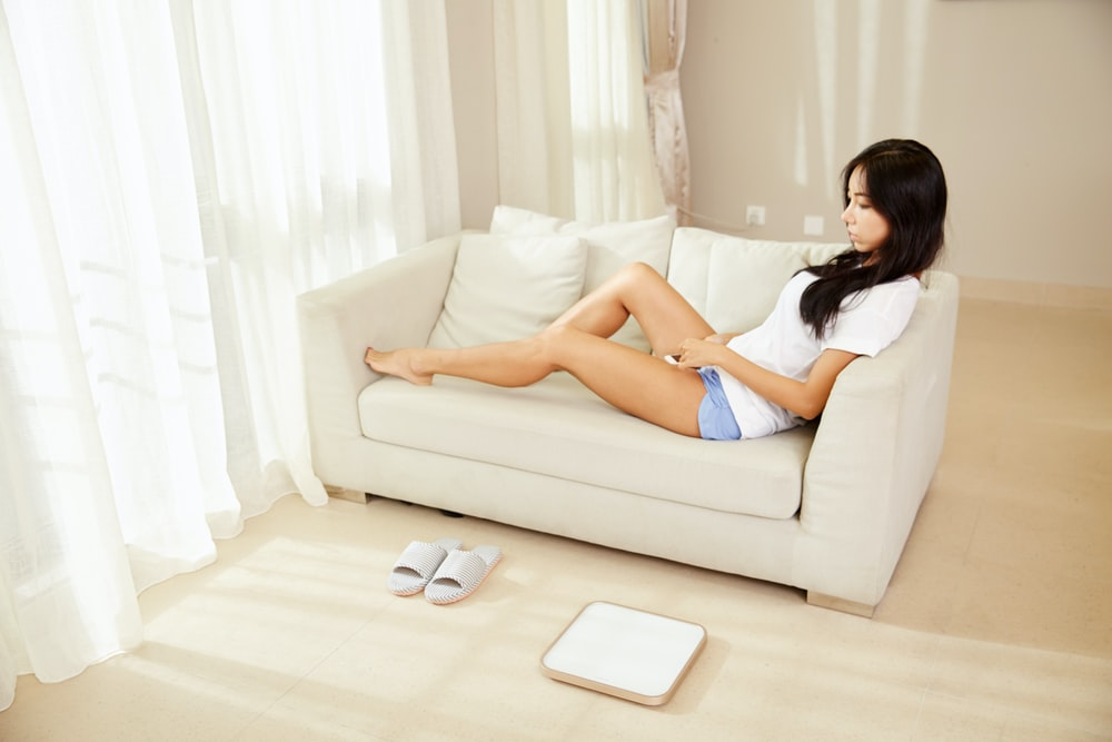woman sitting on white couch