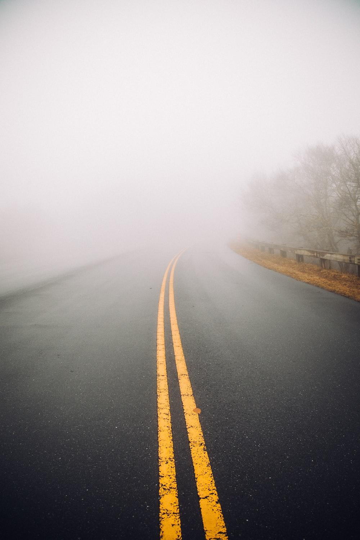 foggy gray concrete road