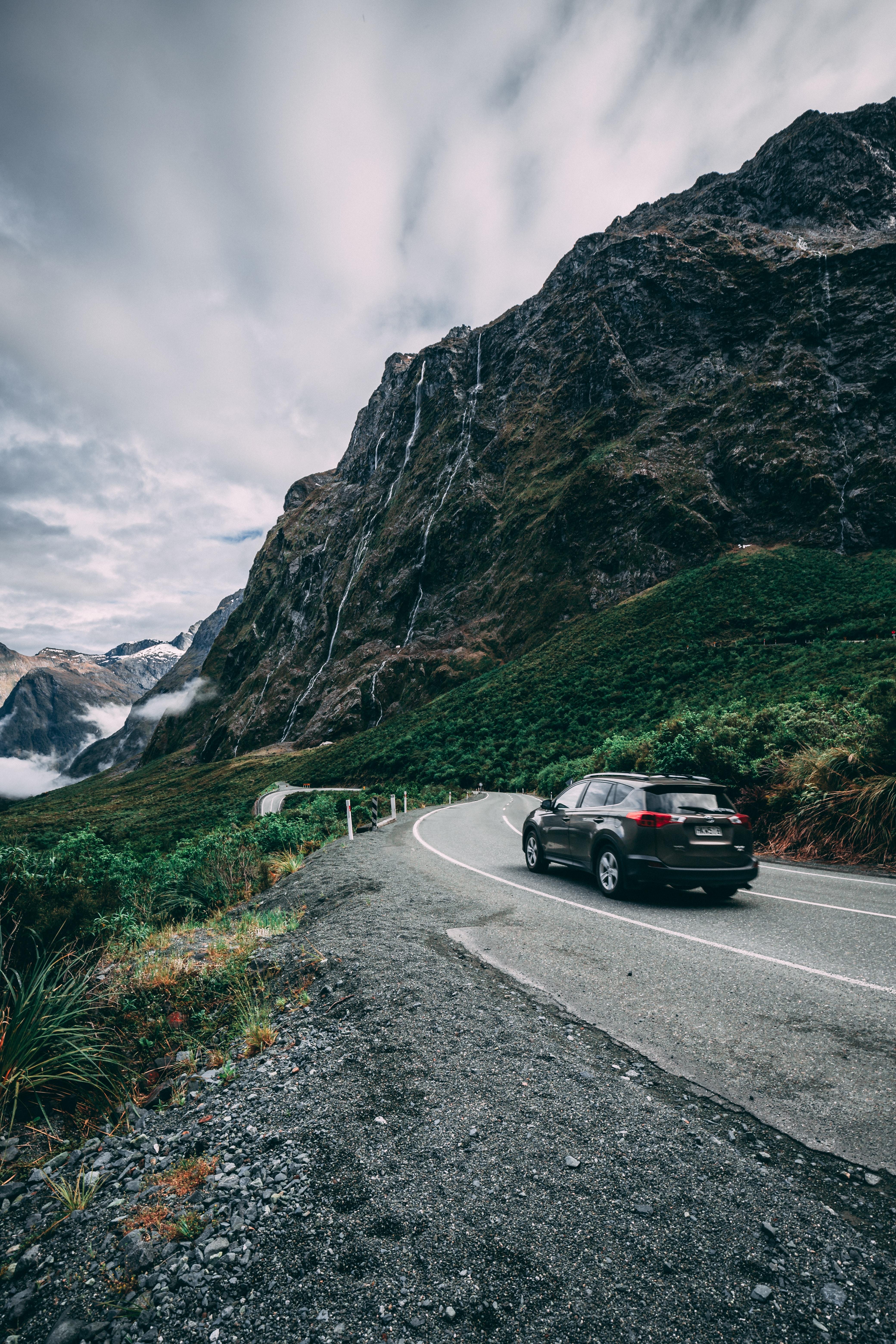 car on road near mountain