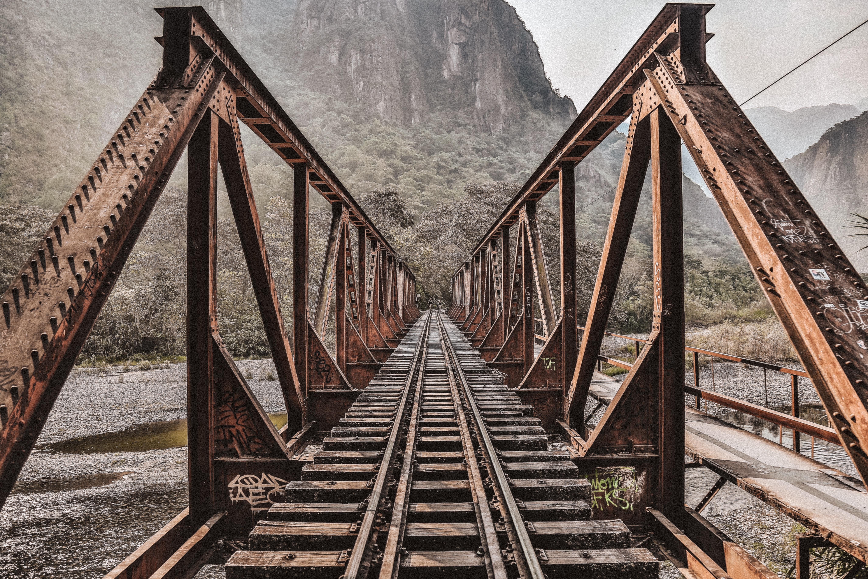 empty brown and gray train bridge at daytime