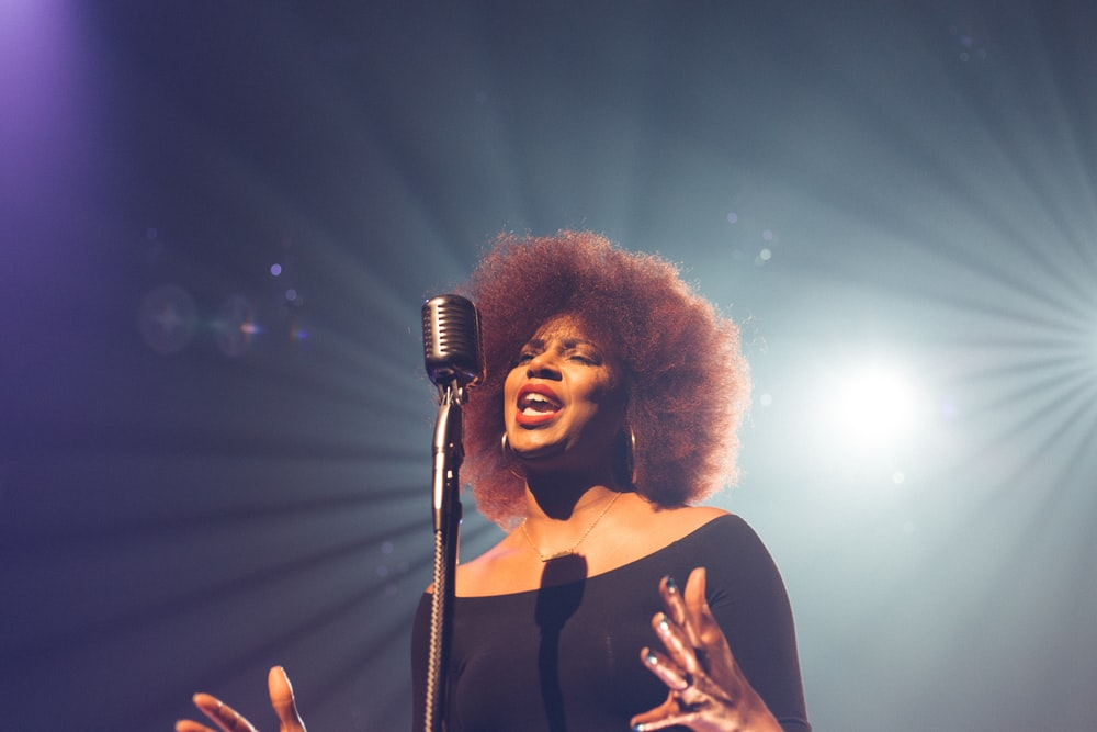 woman performing on stage