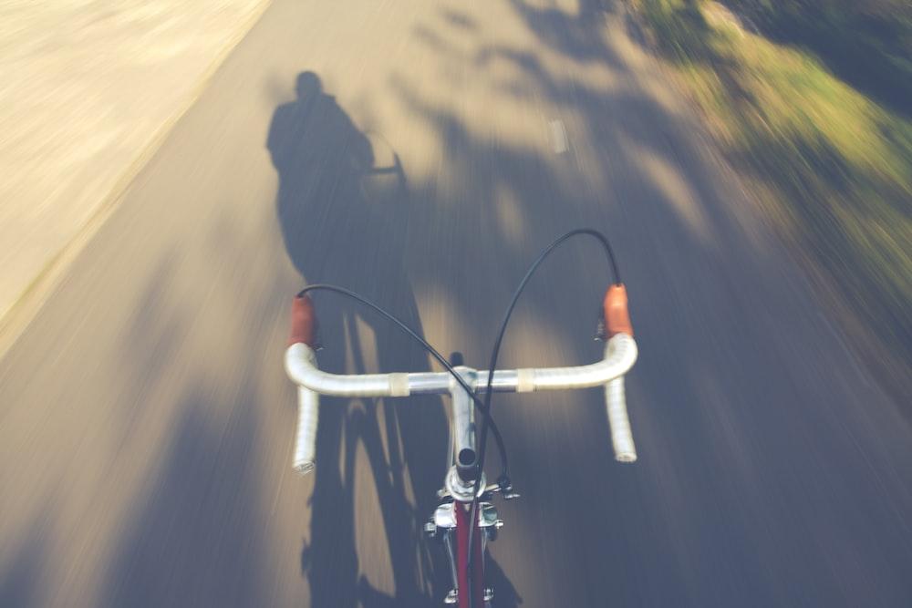 white road bike on road