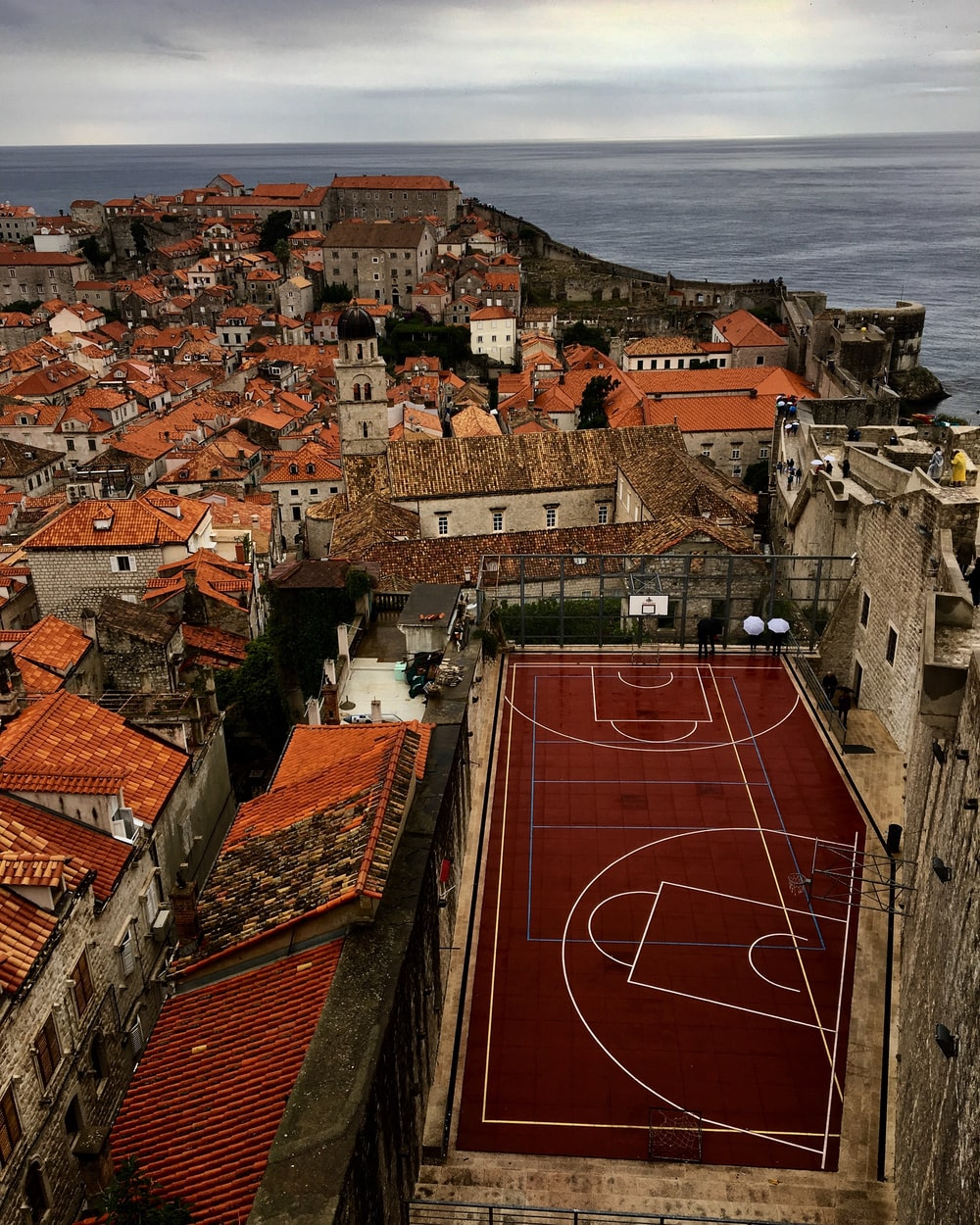 aerial photography of basketball court near town