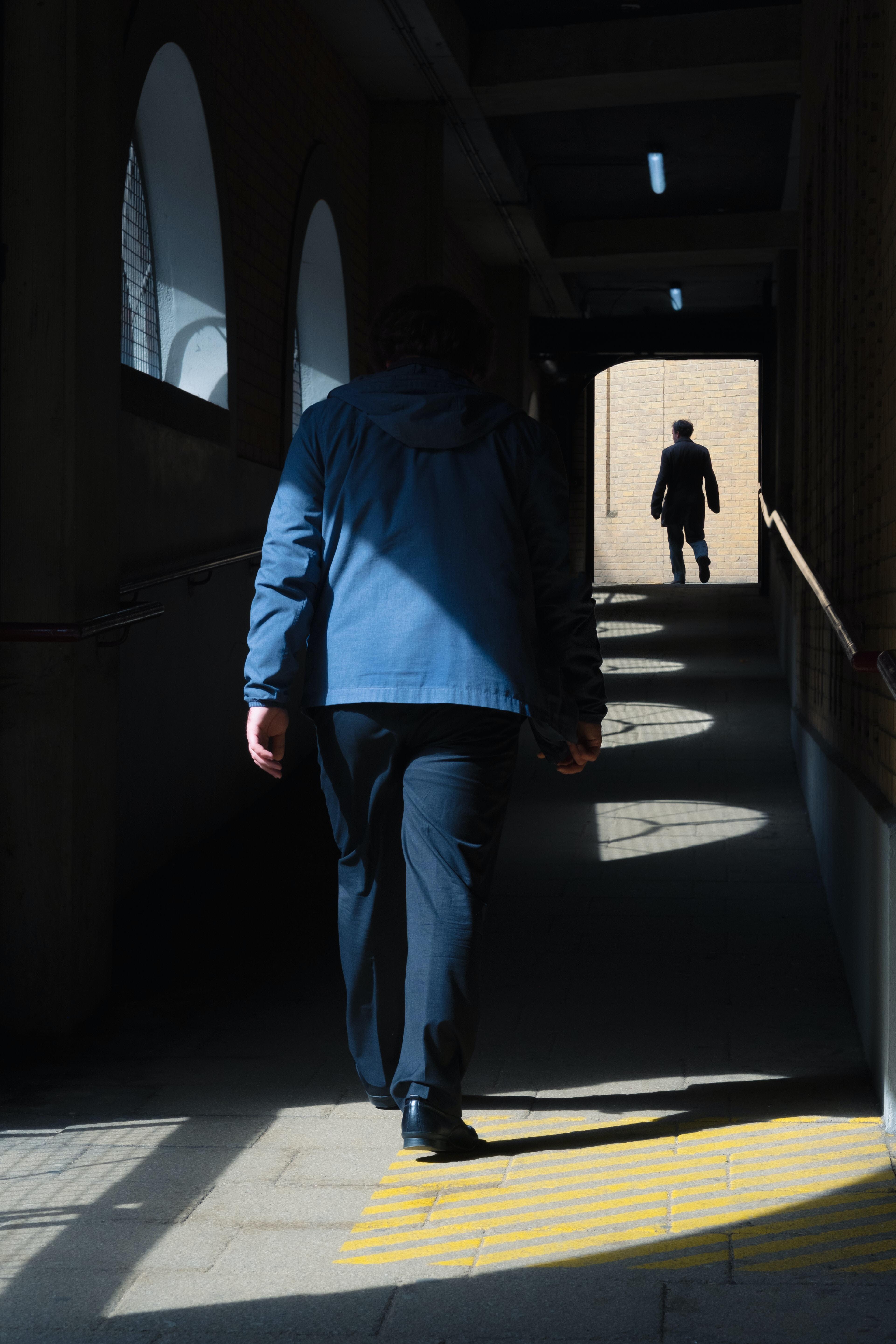 man walking in pathway