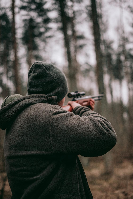 man using sniper rifle