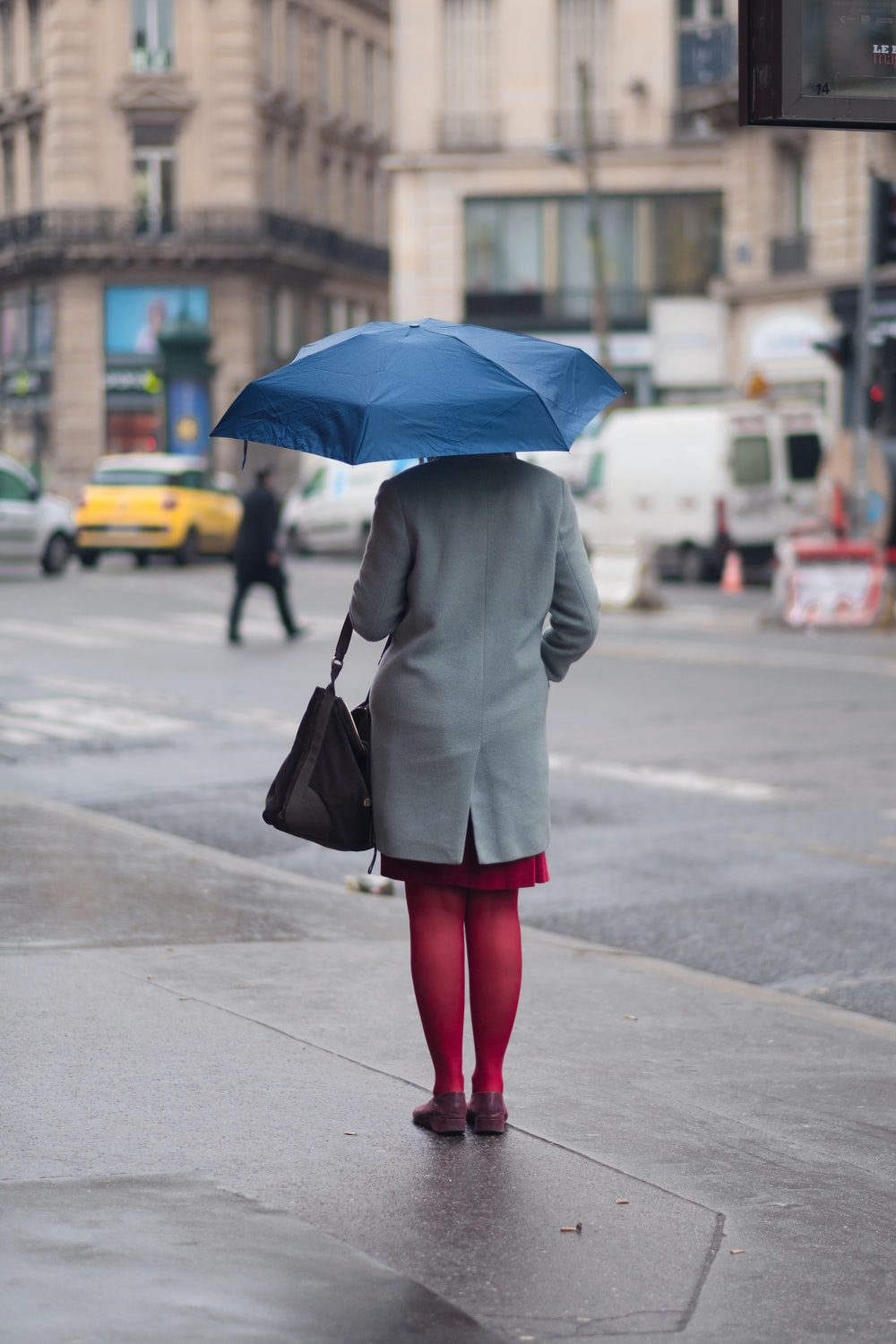 woman standing and holding umbrella