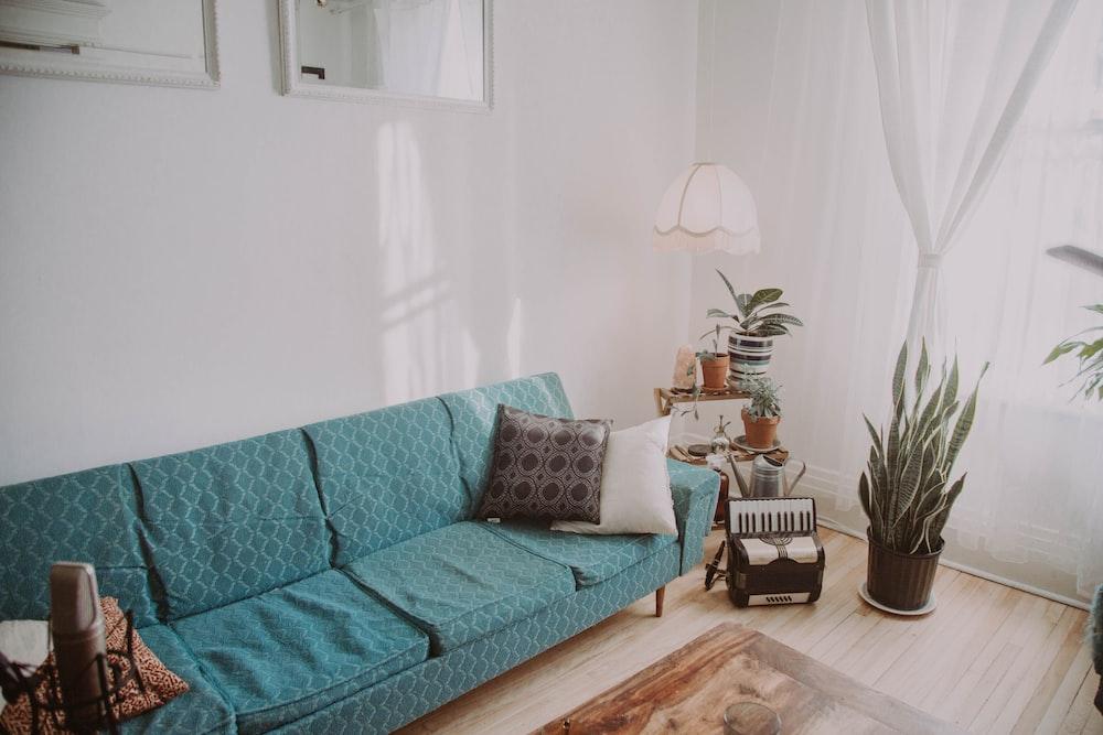 sofa beside accordion on floor