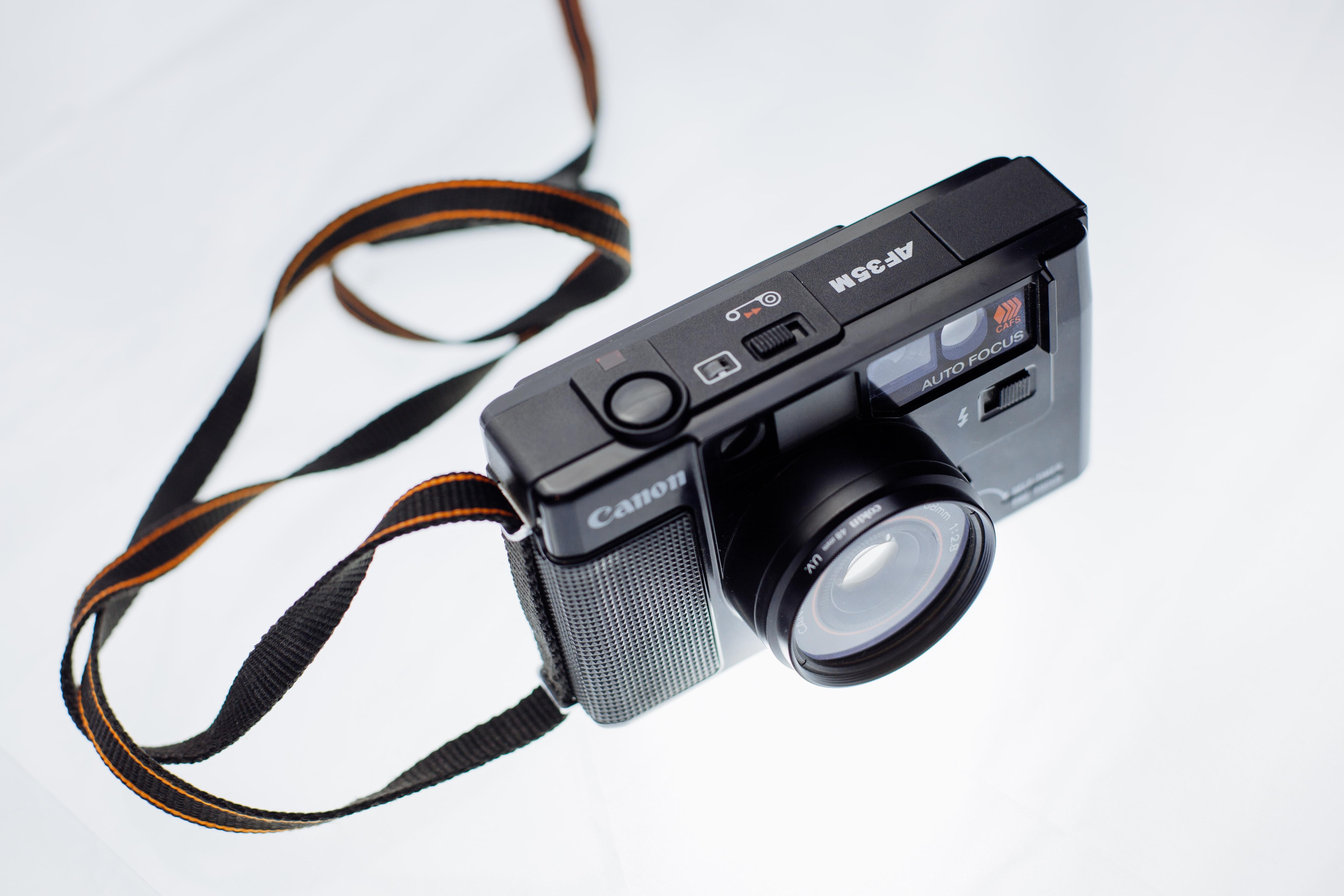 selective photo of Canon camera