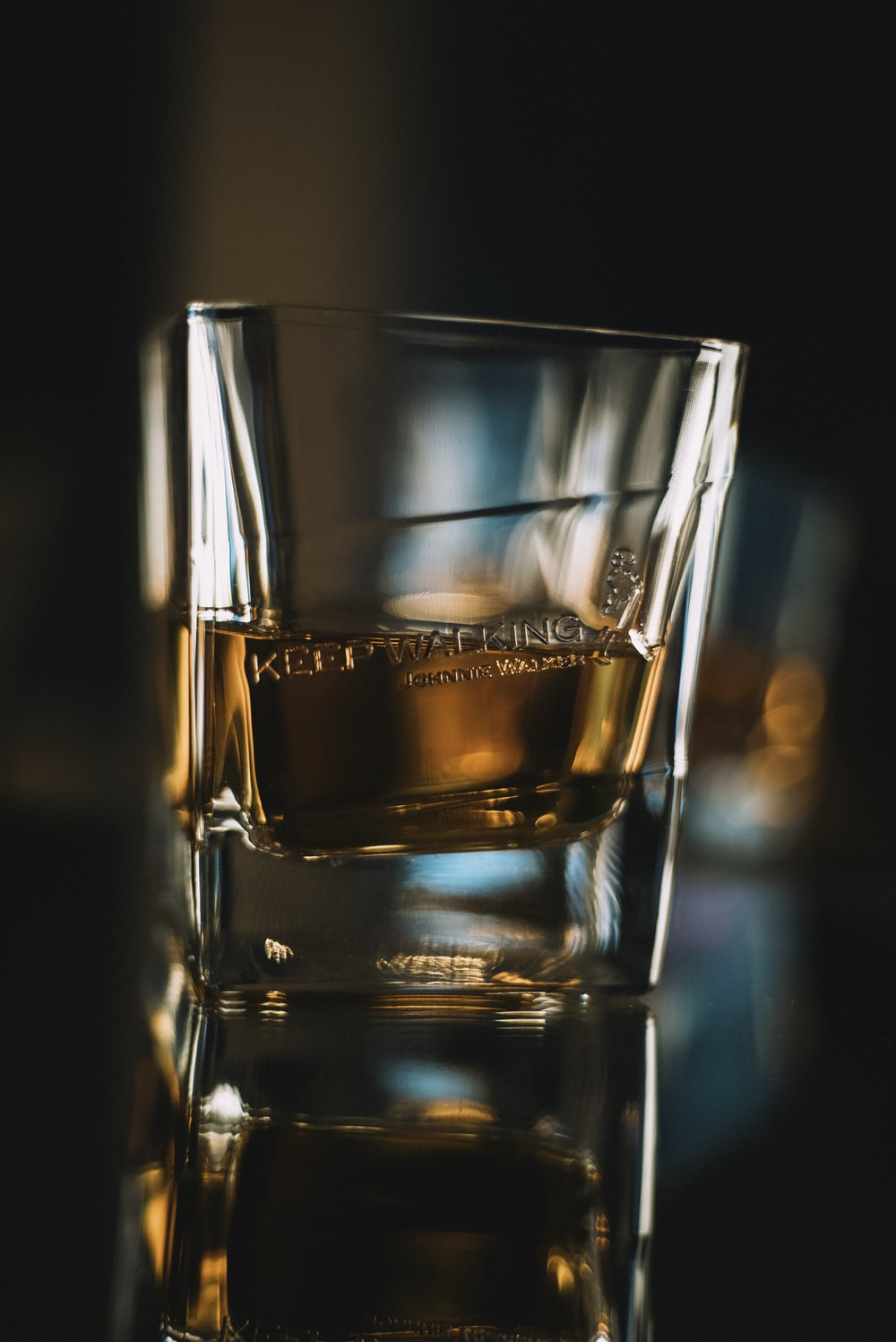brown liquid on clear drinking glass