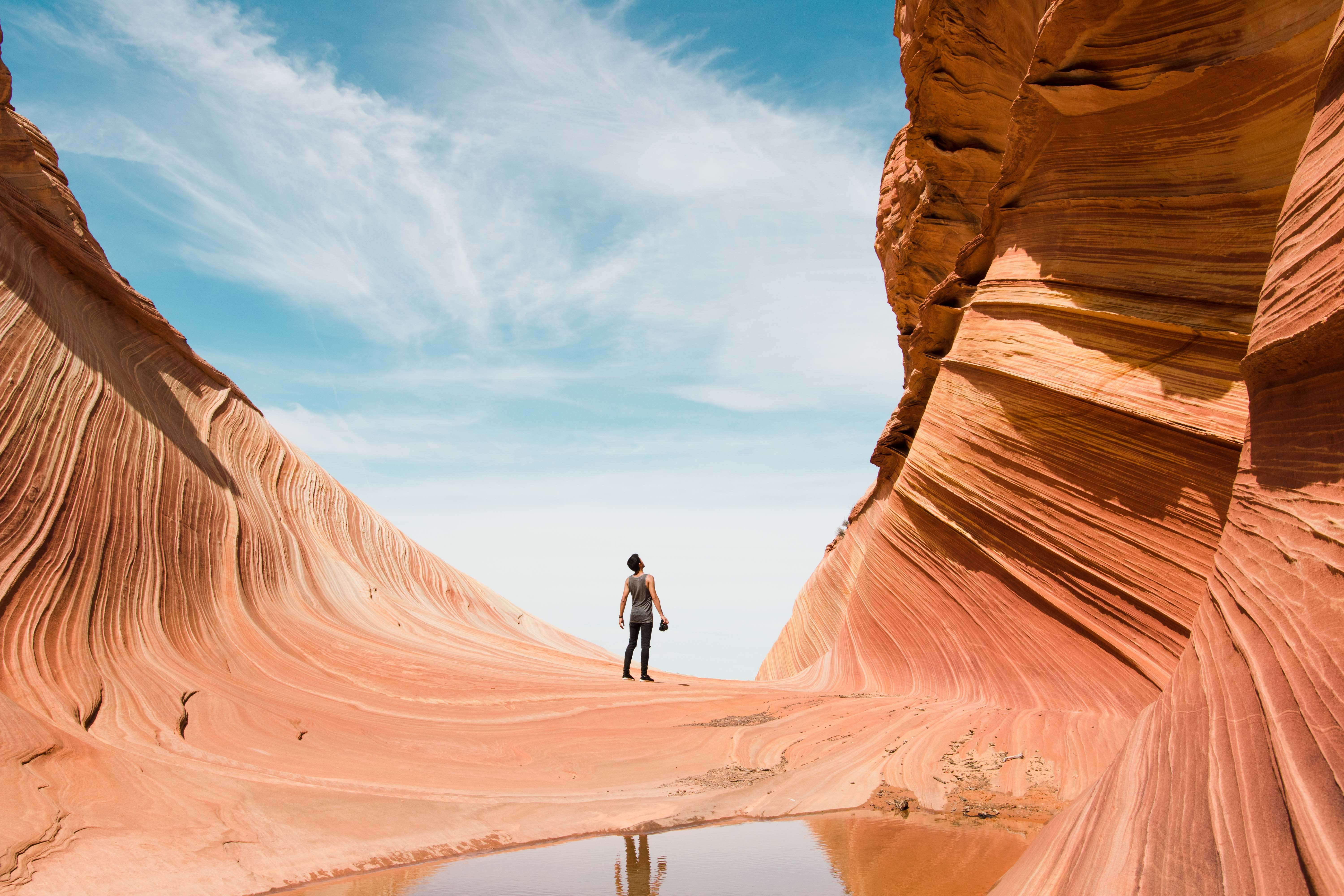 man on antelope canyon during daytime