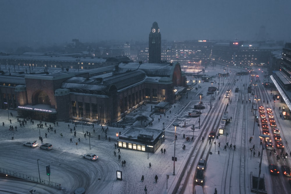 aerial photography of street at night covered with snow