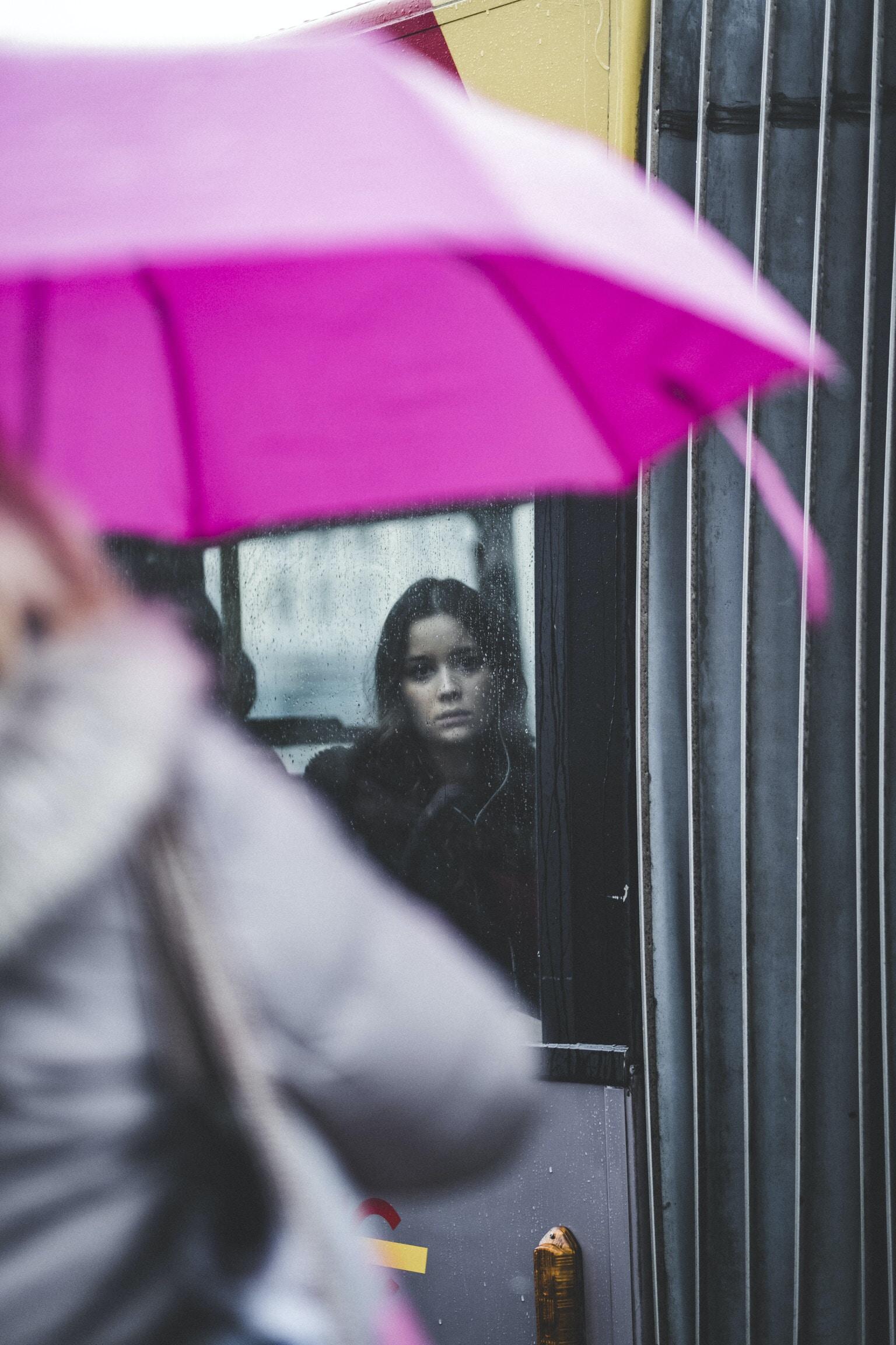 woman standing inside glass window