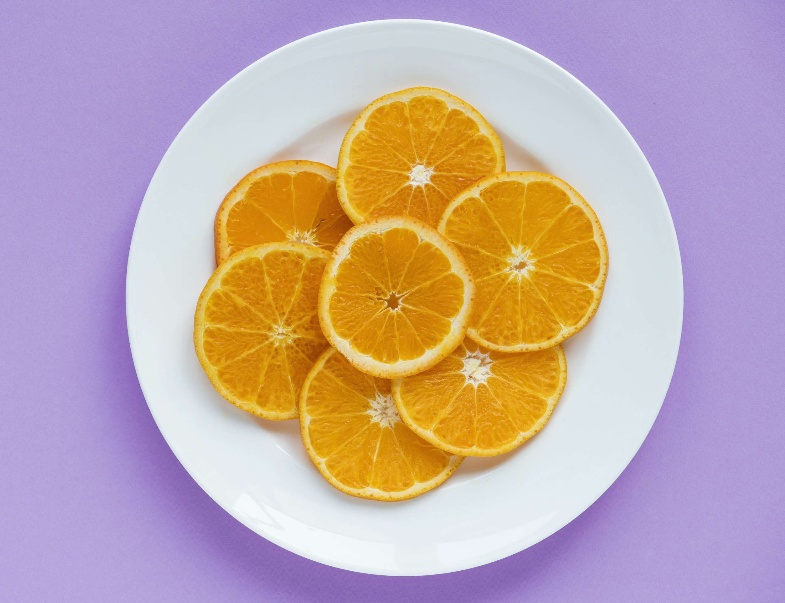 slice of orange fruit on plate