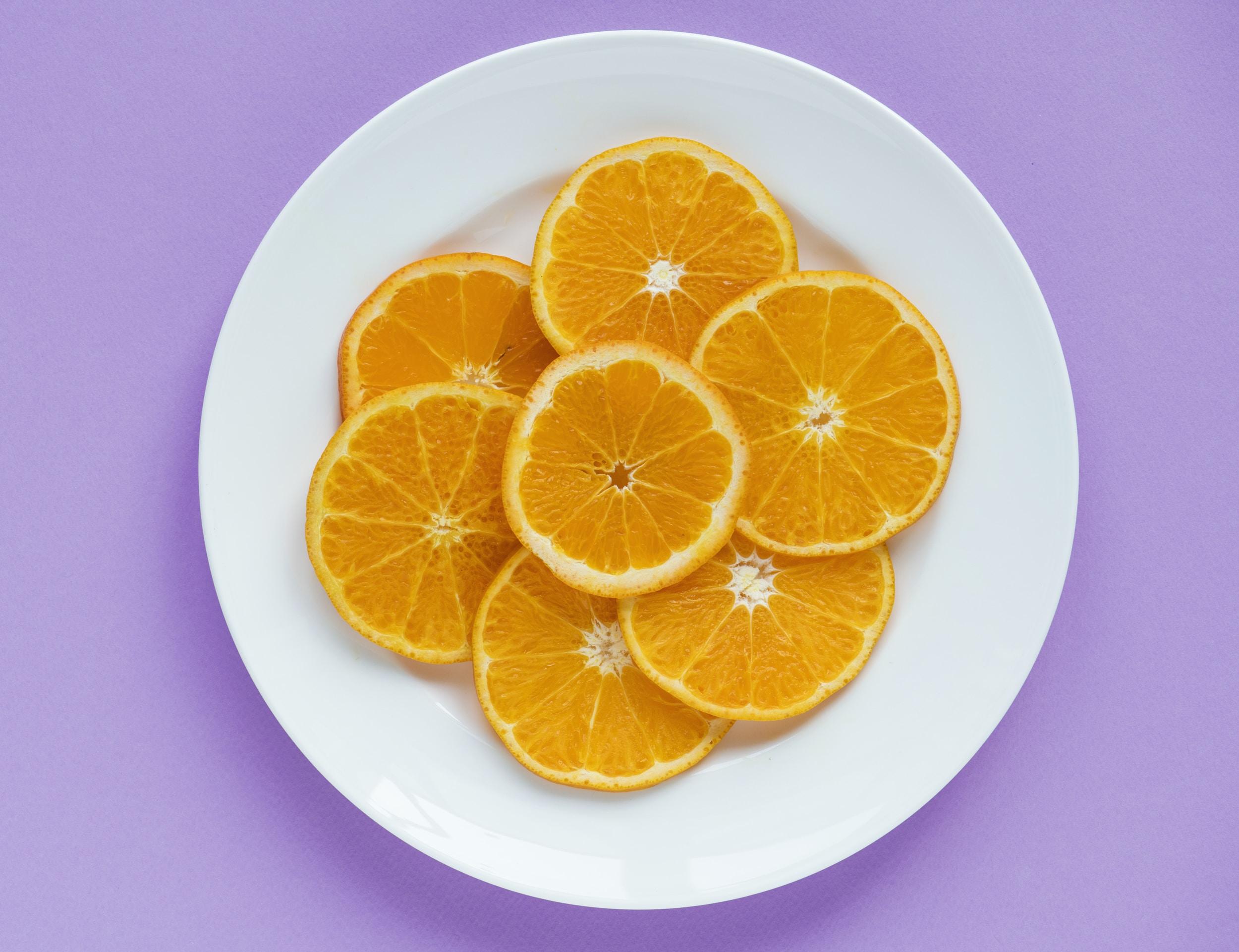 slice of orange fruit on plate