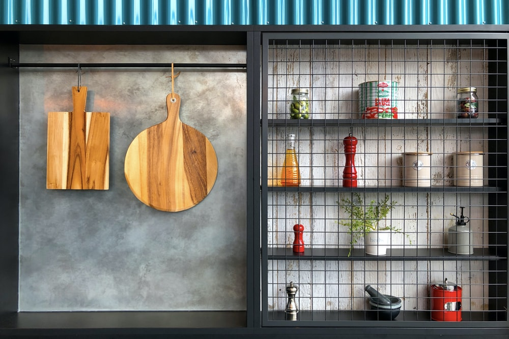 two hanging brown wooden boards \
