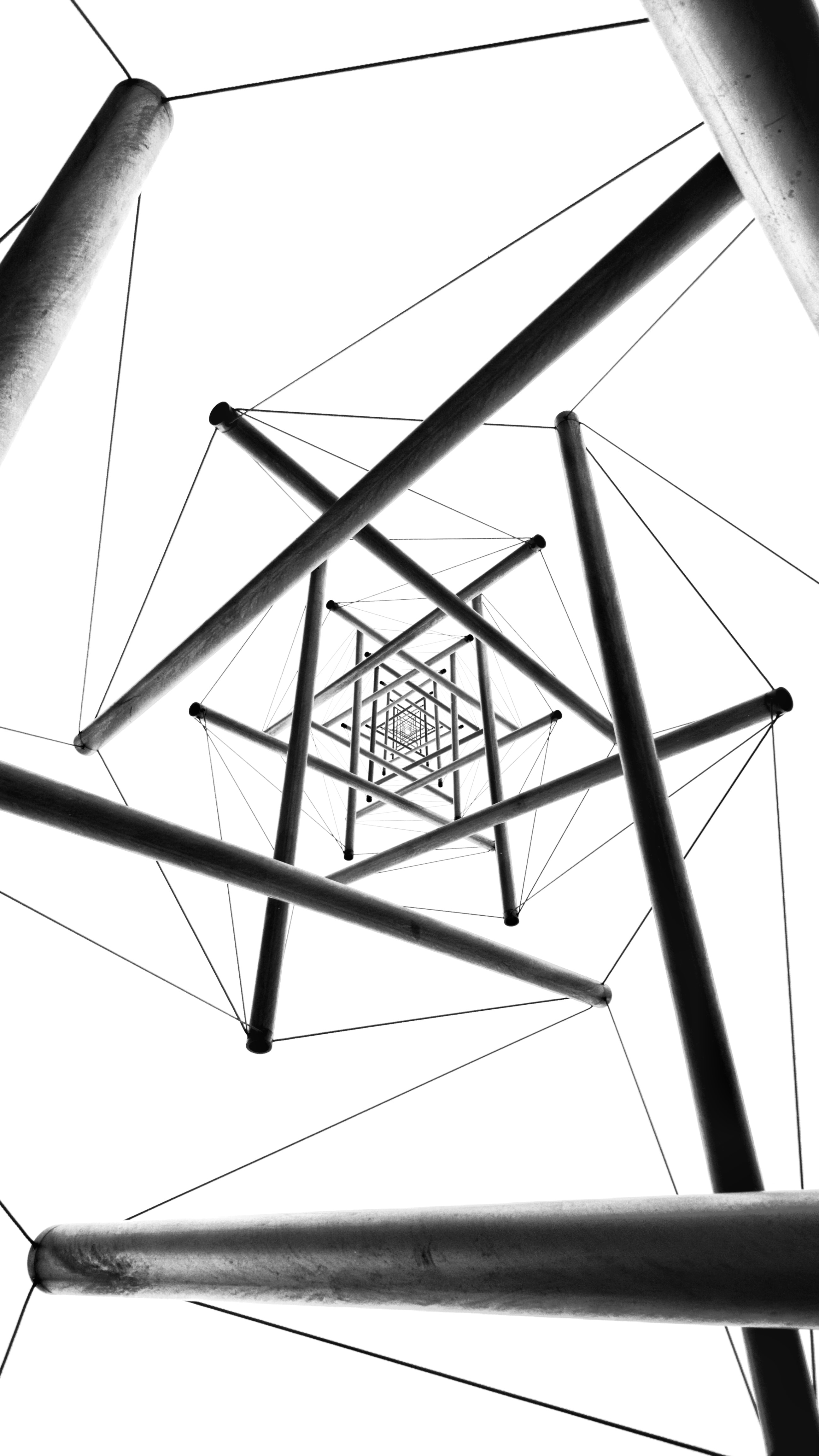 low angle photography of gray metal structure