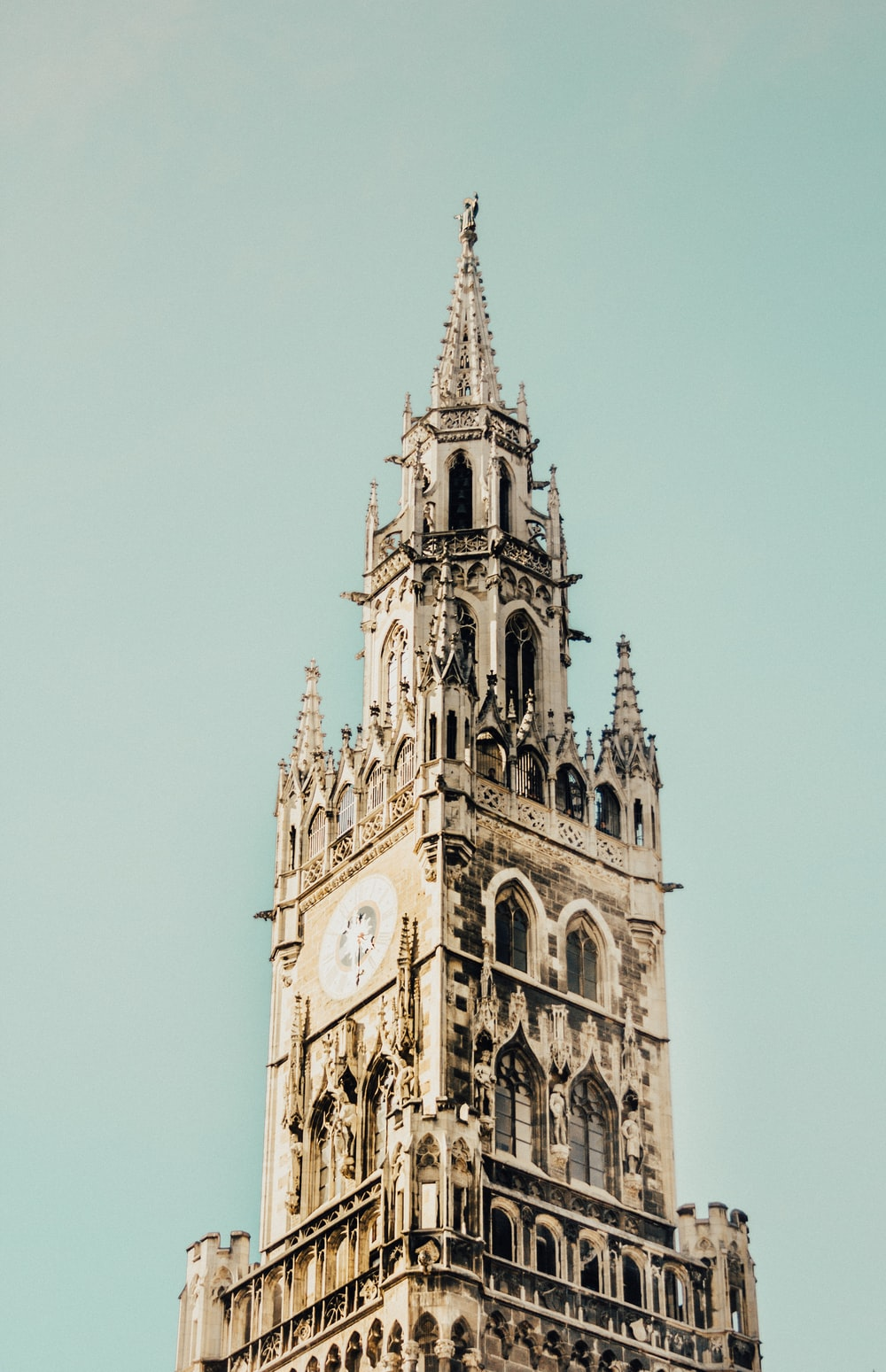 low-angle photography of beige concrete tower clock